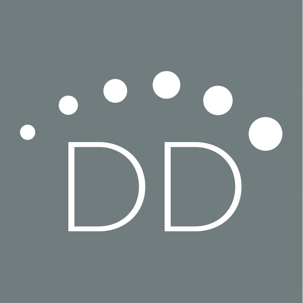DesignDot-Badge---Reverse-on-Gray.jpg