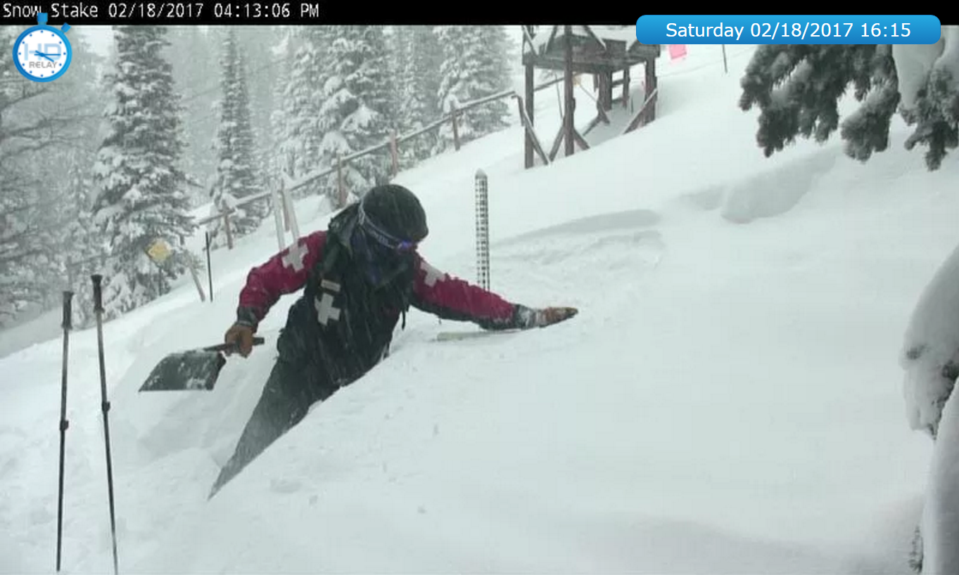 This typically happens once a day: a member of ski patrol cleans off the stake so it doesn't get buried and we can start an new tally for the 24hr cycle.