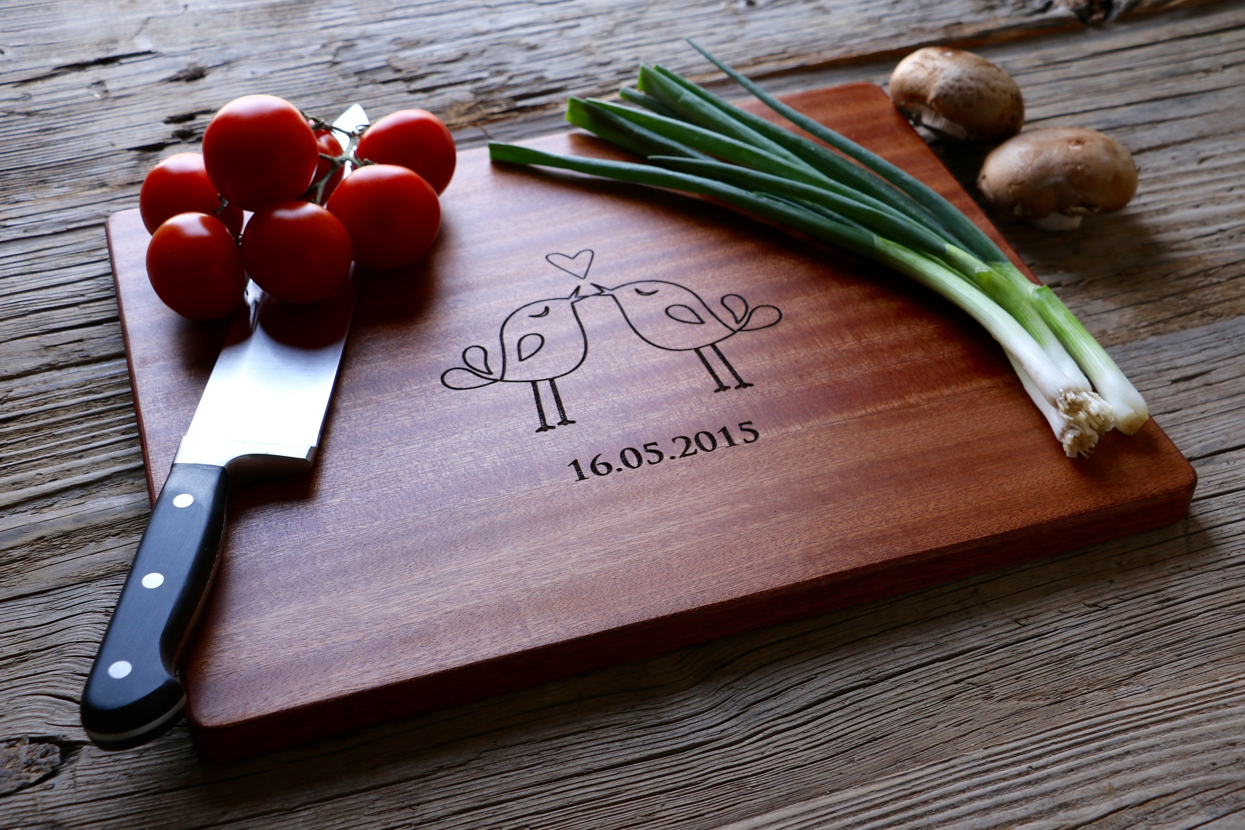 Sapele Wood Cutting board with Love Birds design engraved.