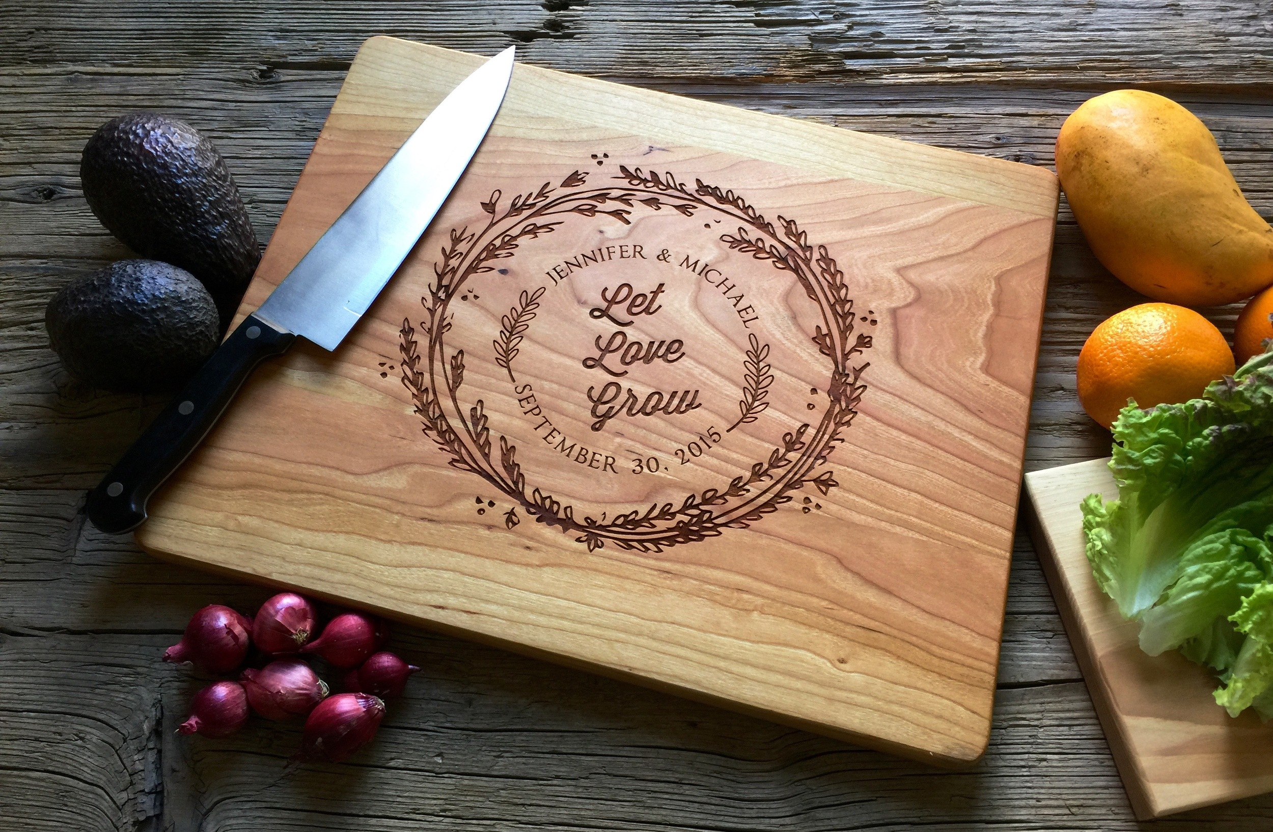 """Cherry Cutting Board with """"Let Love Grow"""" wreath design"""