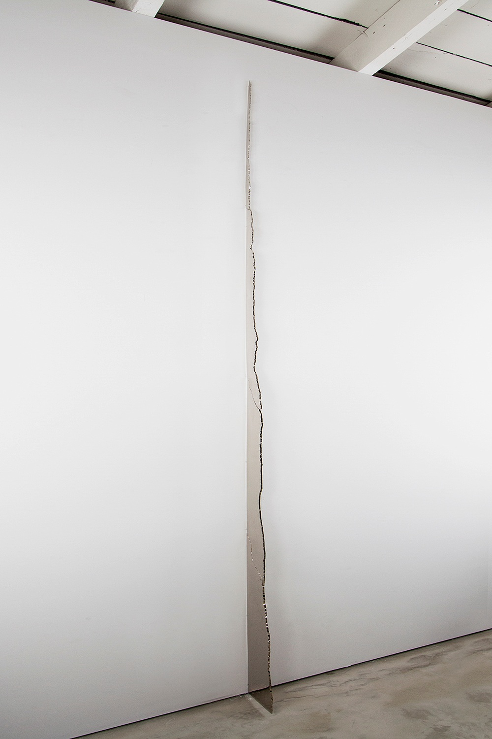 Band, 2013. Nickel plated and mirror polished steel, 120 x 10 x .25 inches -