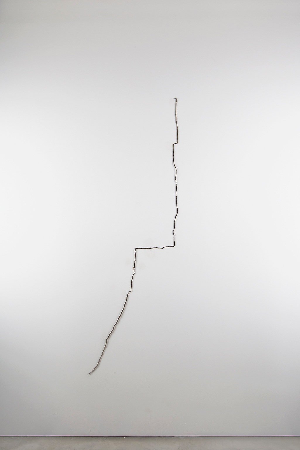 Augustine Mihrab, 2013. Nickel plated and mirror polished steel, 70 x 40 x .25 inches -