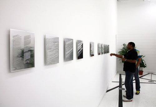 Installation view of 9 collection statements, 2009Engraved polished aluminum12 x 9 inches ea. -