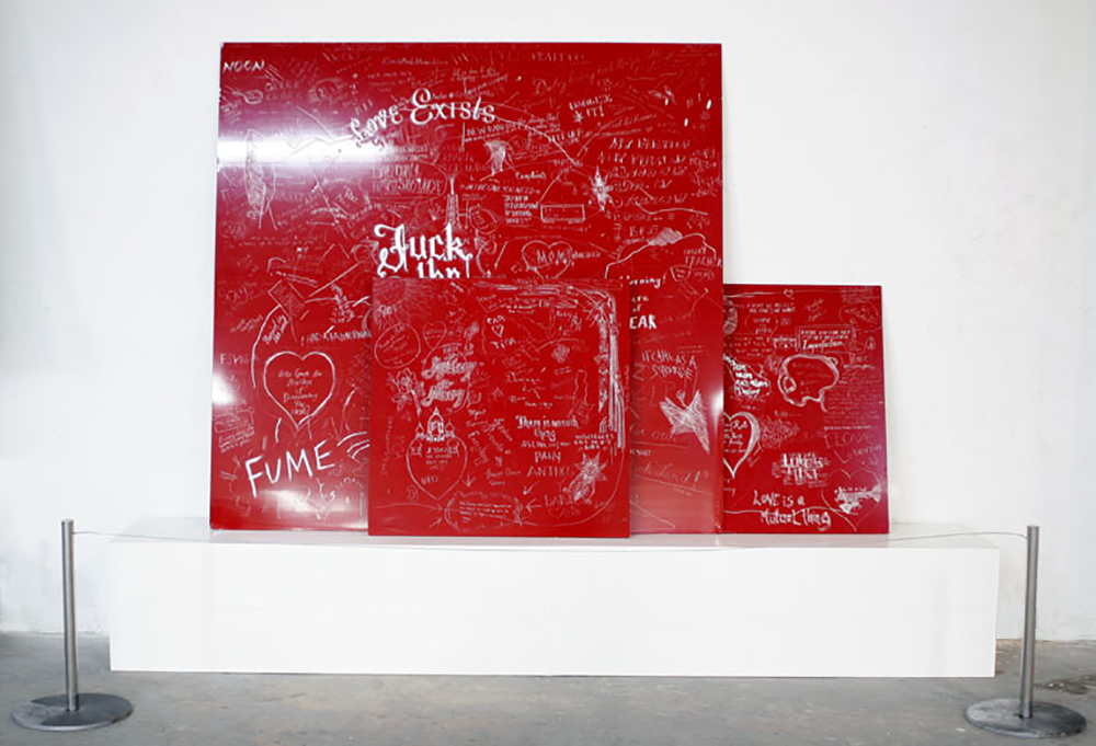 Love and Complaints (Chicago Downtown Pedway), 2008Stacked, carved and incised painted aluminum panels, 3 parts Crowd sourced group drawing68 x 48 inches -