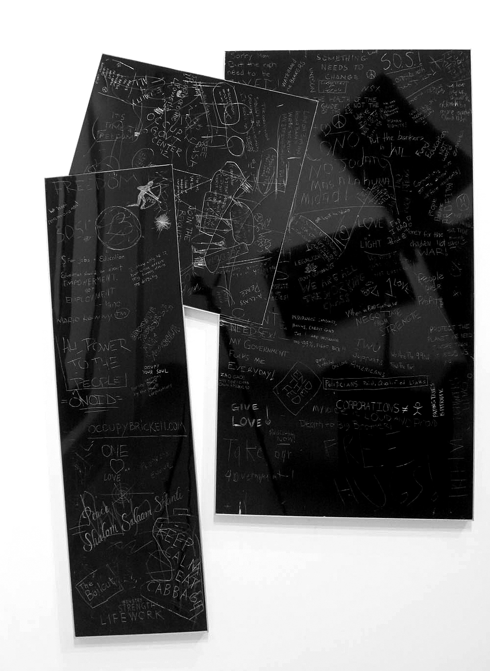Protest (Occupy/Protest, Miami Metro Area), 2012Adjoined, framed, carved and incised painted aluminum panelsCrowd sourced group drawing80 x 50 inches -