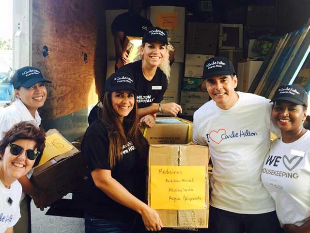 Hilton Caribe Hotel staff volunteering at a collection drive to benefit victims of hurricanes Irma and Maria, the latter of which has devastated the island of Puerto Rico.  More on how Hoteliers responded to the effects of Hurricane Maria  here .
