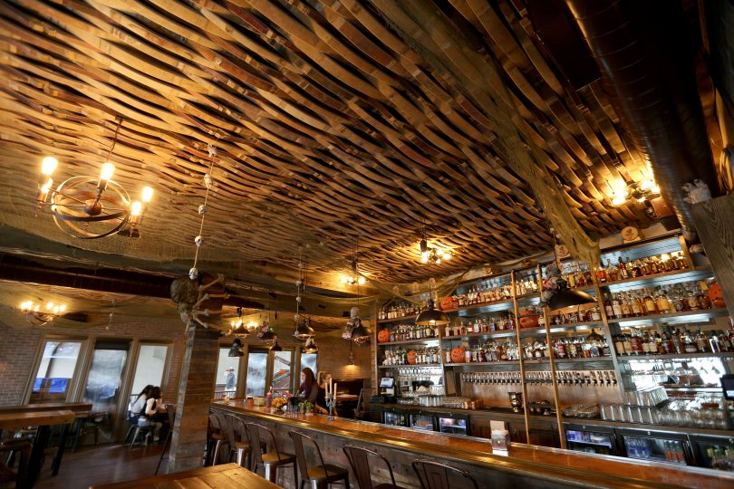 The Beer Baron Bar and Kitchen, with its ceiling made of wood barrel staves, is just the ticket for a memorable first date. (Anda Chu/Bay Area News Group) Anda Chu/Bay Area News Group
