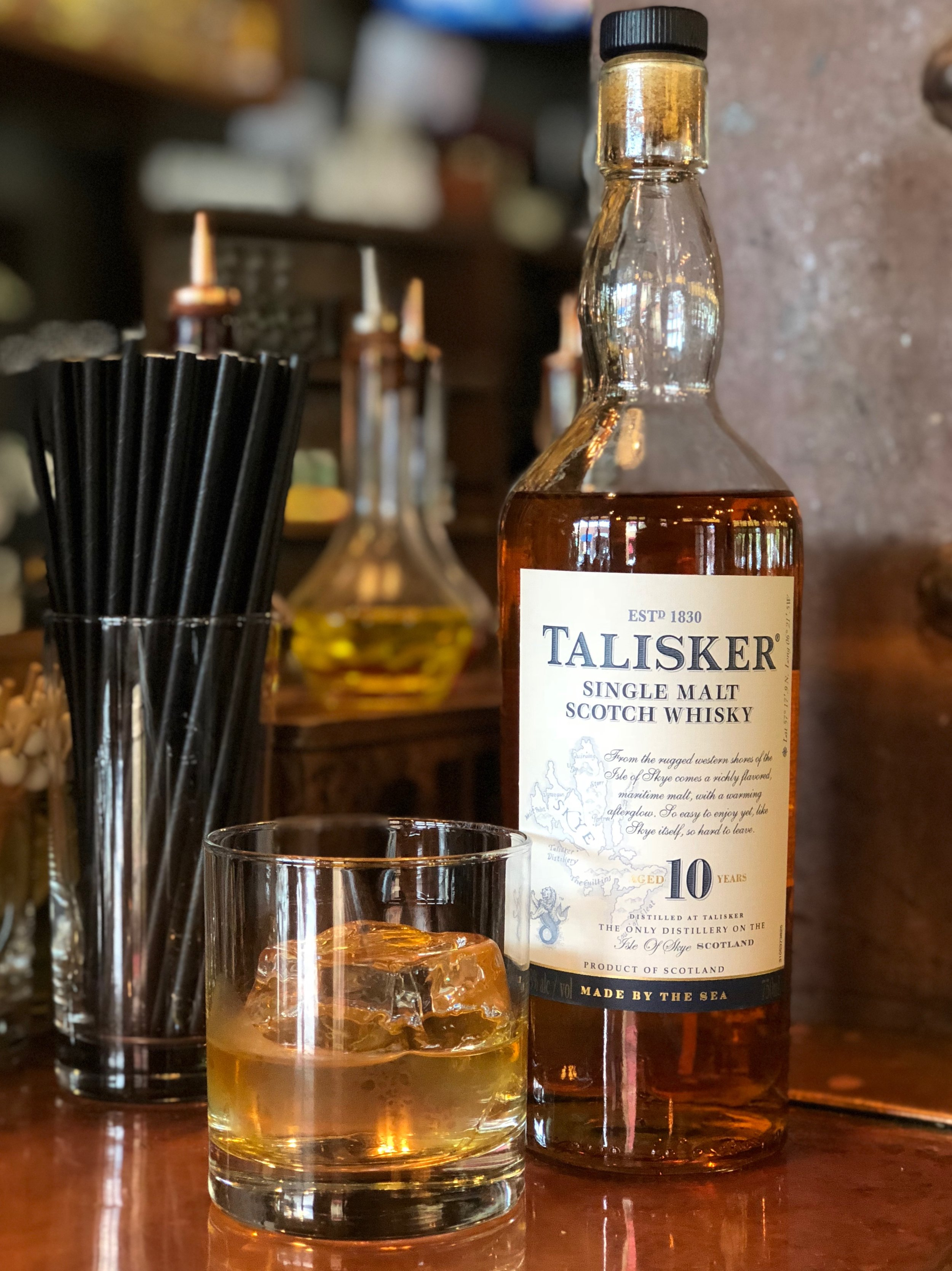 """Whatever would we do without Whiskey Wednesday? . This Wednesday we bring you a Single Malt Scotch Whiskey. This made by the sea scotch whiskey, Talisker 10 Years Old, is pungent with apple peels, smoke, and kippers on the nose and has a volcanic, peppery peat, barley, and lemon zest taste on the palate. """"It is the perfect companion for when the day is done"""". . All day Wednesday, all whiskeys $10/oz and under are 50% off! Come try this scotch whiskey for only $3.50! Cheers!"""