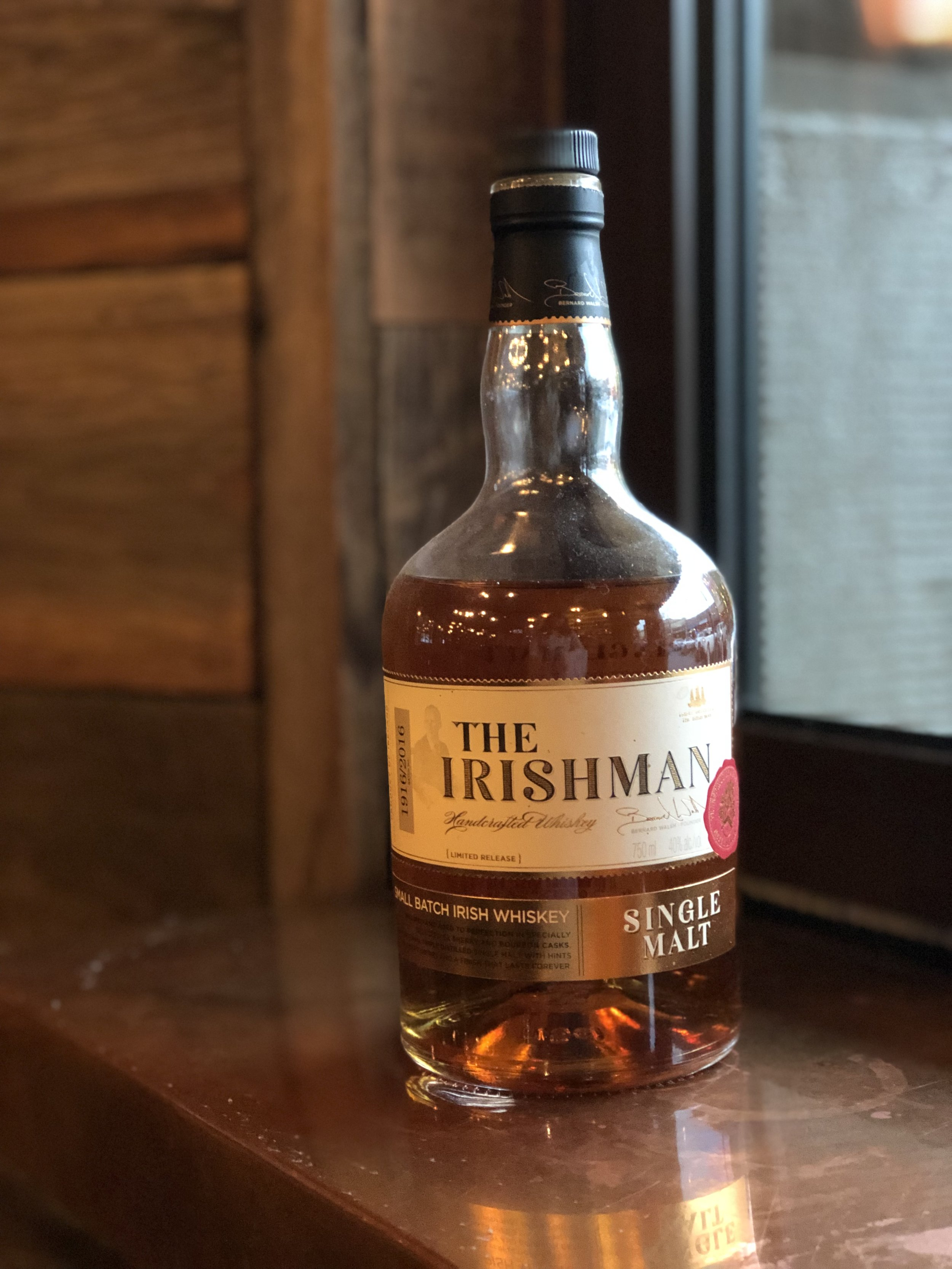 """Rain or shine, any weather can be whiskey weather. Come in to Beer Baron this Whiskey Wednesday and try The Irishman Single Malt. . """"This Irishman Single Malt is one of only a handful of Irish triple distilled single malts on the market. This is a classic Irish Malt, triple distilled and aged in Oak Bourbon and Oloroso Sherry Casks to give exceptional flavour and complexity. Each batch is limited to a maximum of 6,000 bottles. The Irishman Single Malt boasts an impressive medal haul both in Europe and the USA for its outstanding quality. None more so than a Double Gold Medal """"The World Spirits Competition"""" in San Francisco and its Gold Medal in ISW Germany. Each bottle carries a batch number and signature as a mark of the highest quality."""" - Walsh Whiskey Distillery . Every Wednesday Beer Baron offers 50% off all whiskey $10/oz and under. Cheers!"""