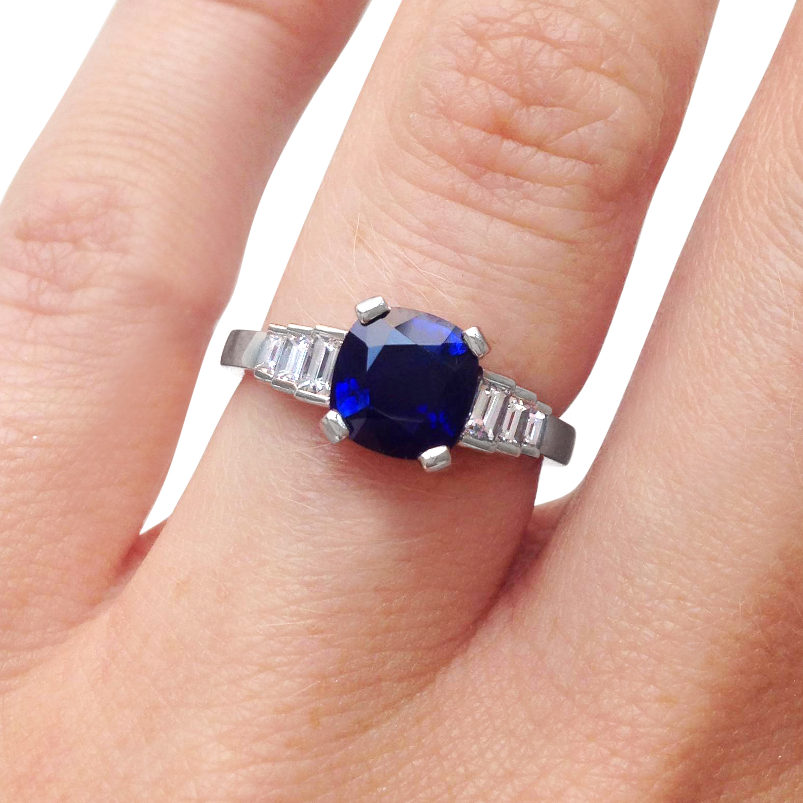 cushion-shpaed-sapphire-and-diamond-baguette-cut-ring-mounted-in-platinum.jpg