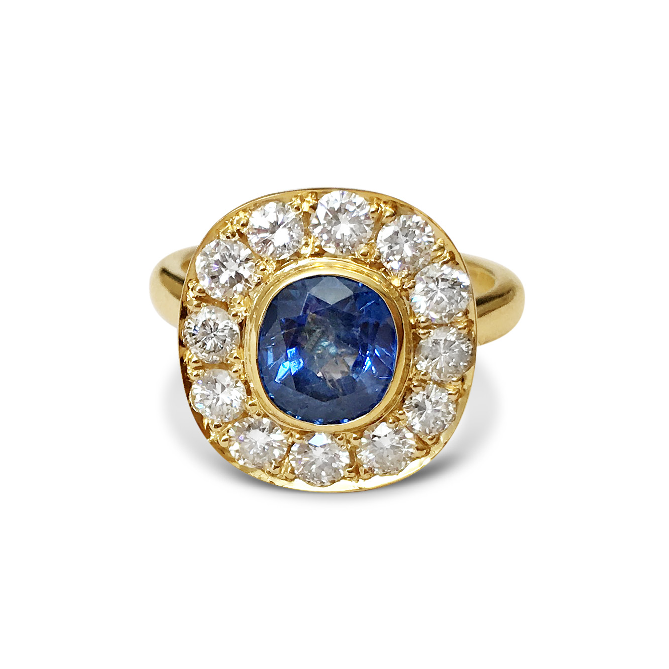 Sapphire-and-diamond-cluster-engagement-ring-in-yellow-gold.jpg