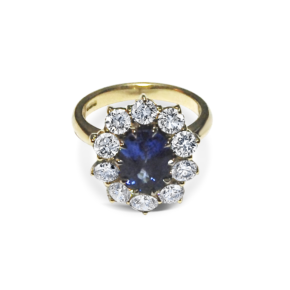 Sapphire-and-diamond-cluster-ring-mounted-in-yellow-gold.jpg