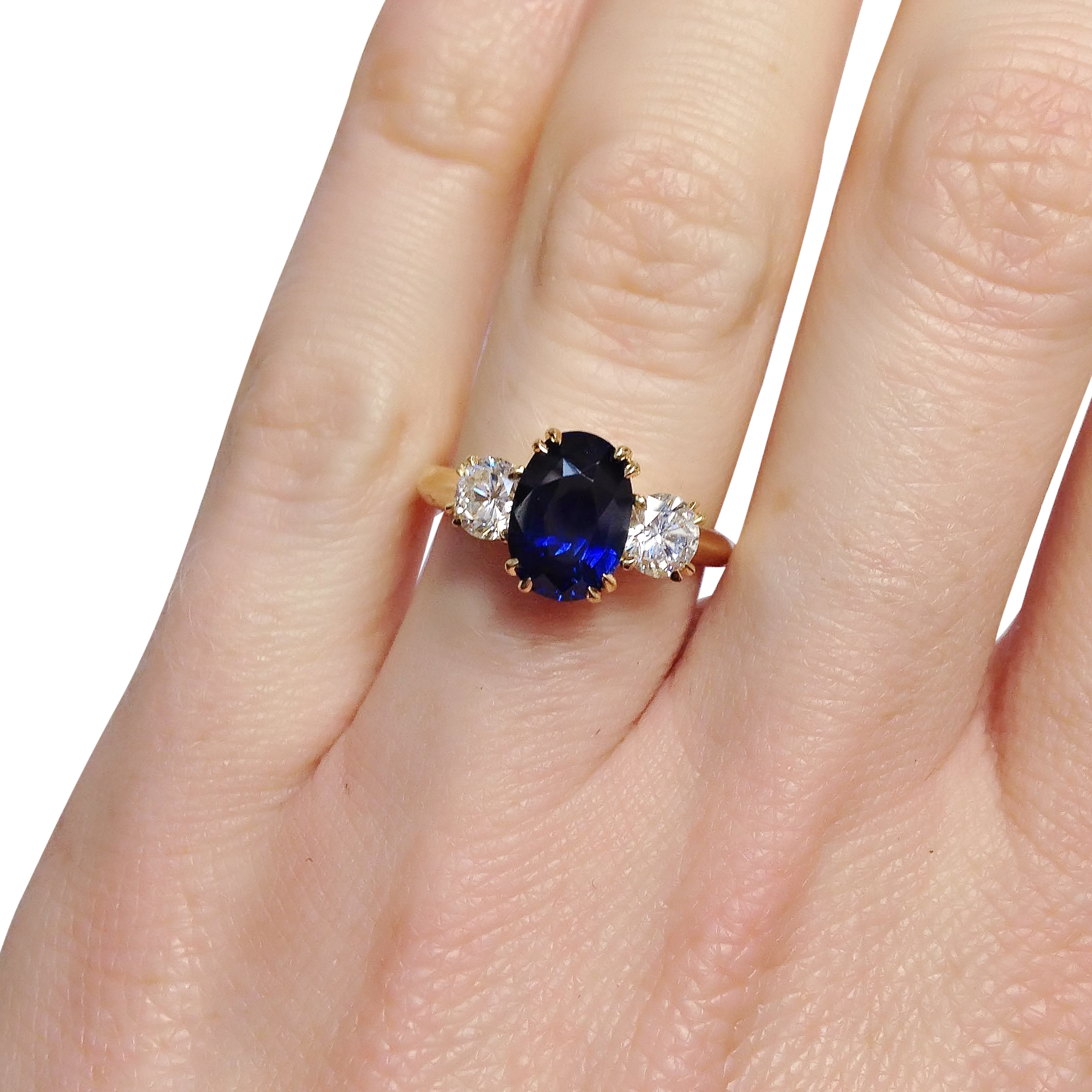 Sapphire-and-diamond-three-stone-ring-in-yellow-gold.jpg
