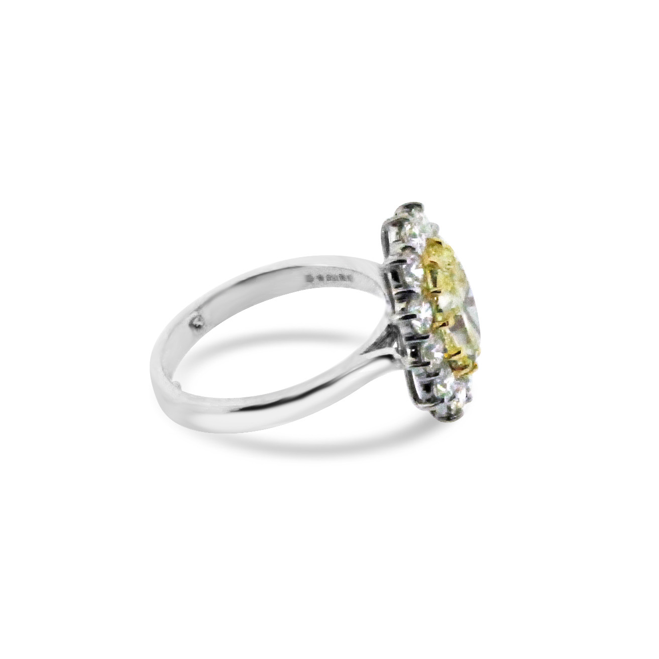 Yellow-diamond-oval-cluster-ring-in-platinum-1.jpg