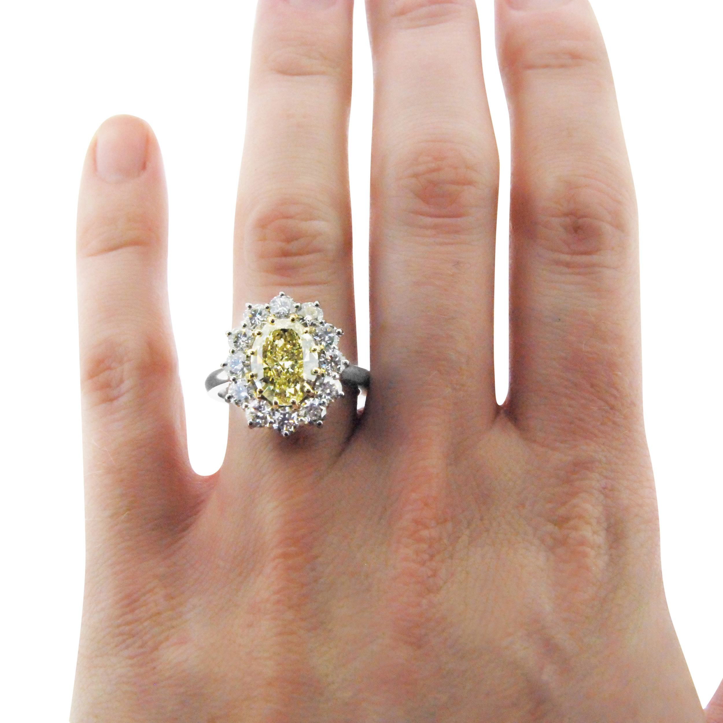 Yellow-diamond-oval-cluster-ring-in-platinum.jpg