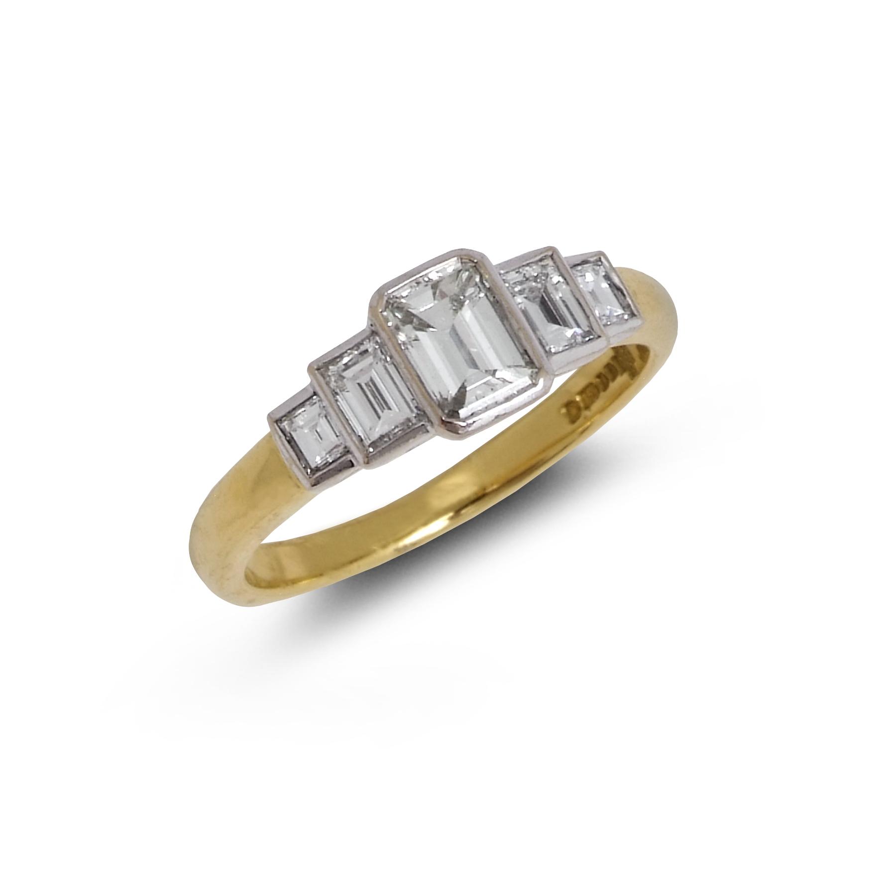 Vintage emerald-cut diamond five-stone ring