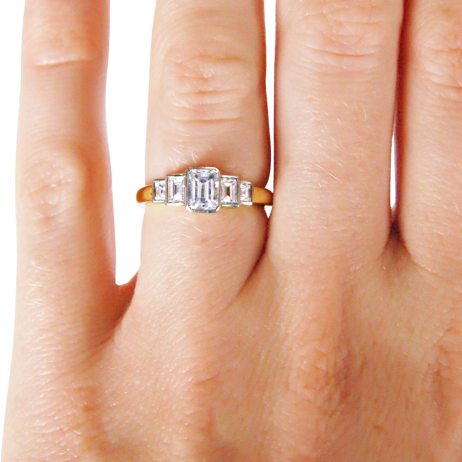Vintage emerald-cut diamond five-stone ring hand shot