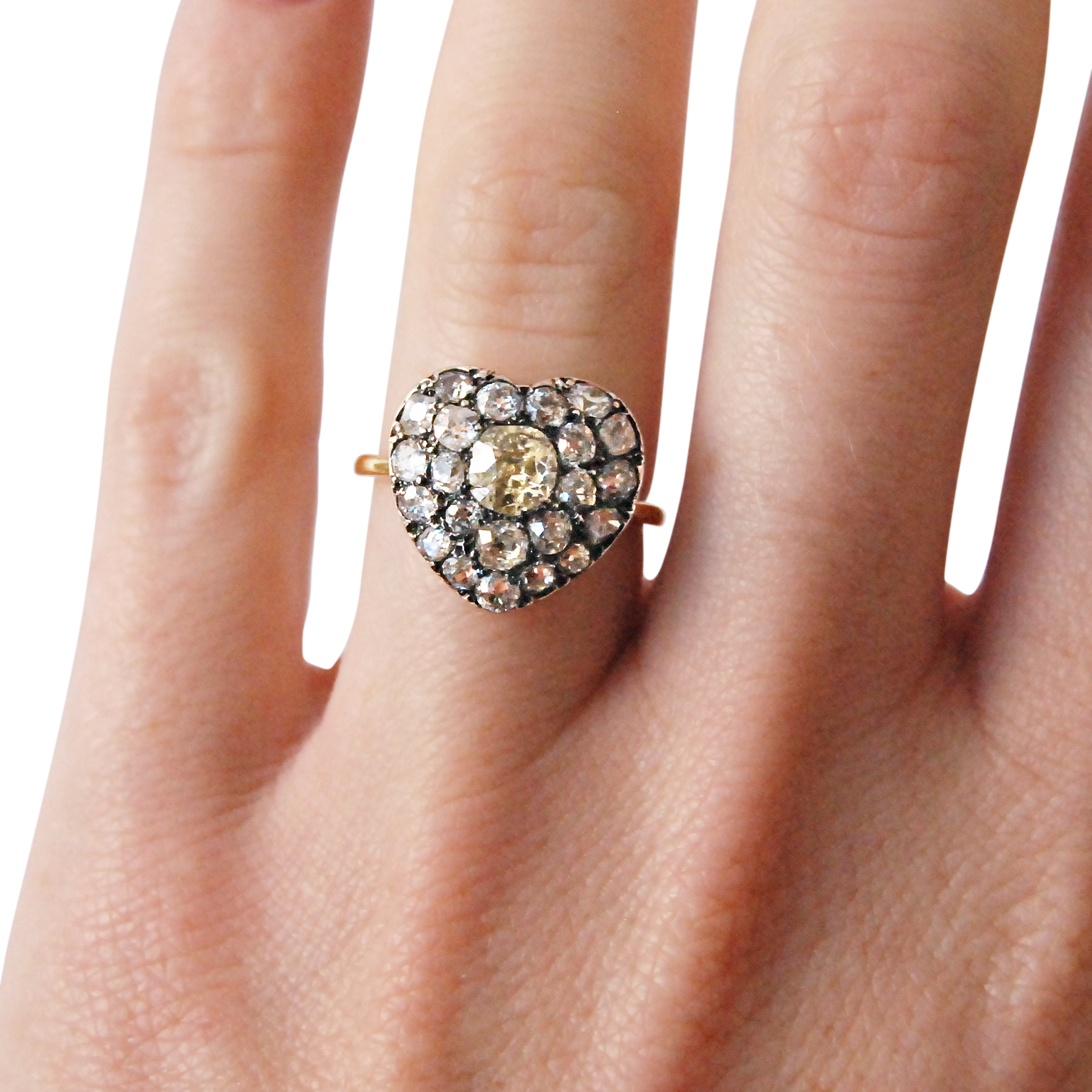Old-cut diamond antique style heart-shaped cluster ring hand shot