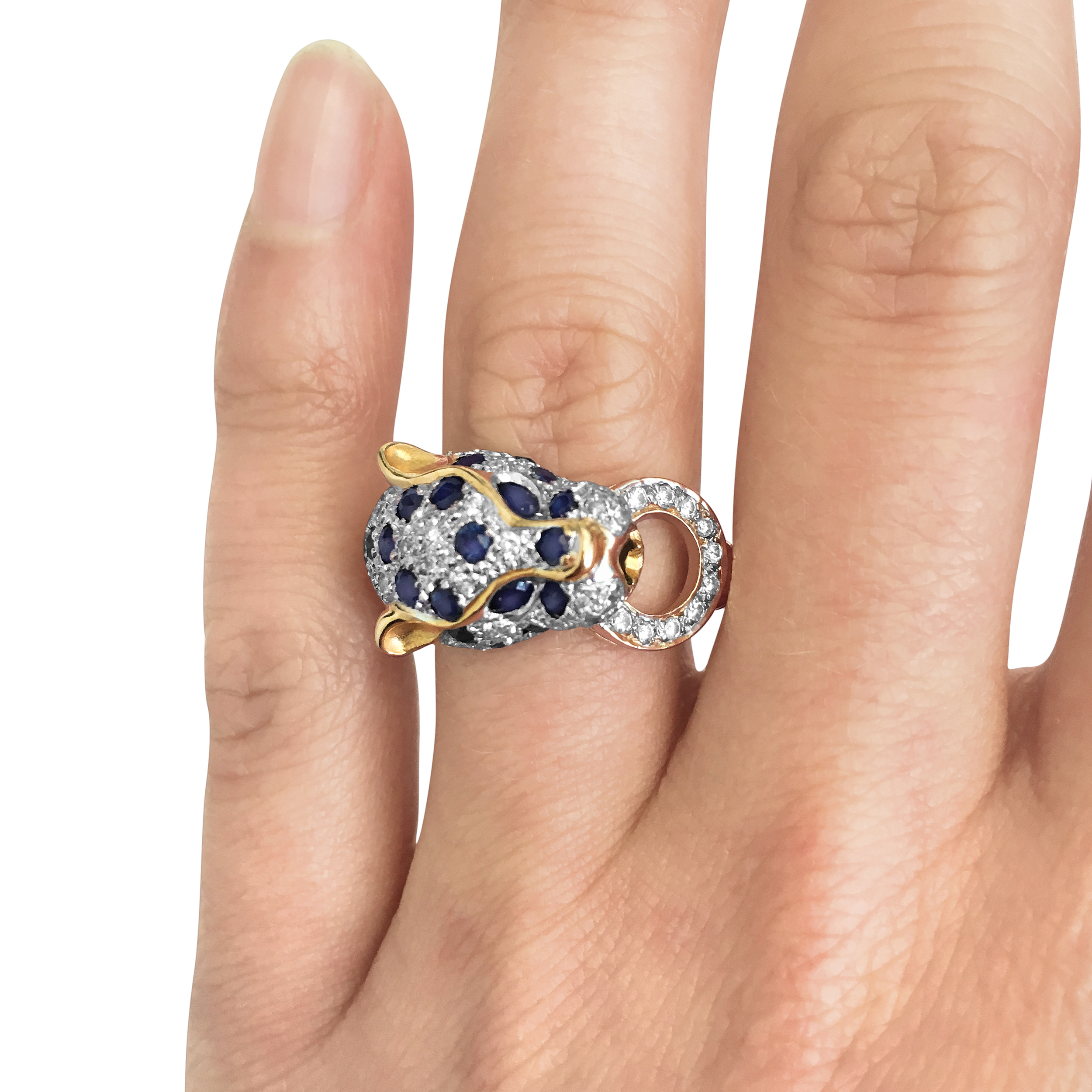 Vintage sapphire and diamond-set panther head ring hand shot