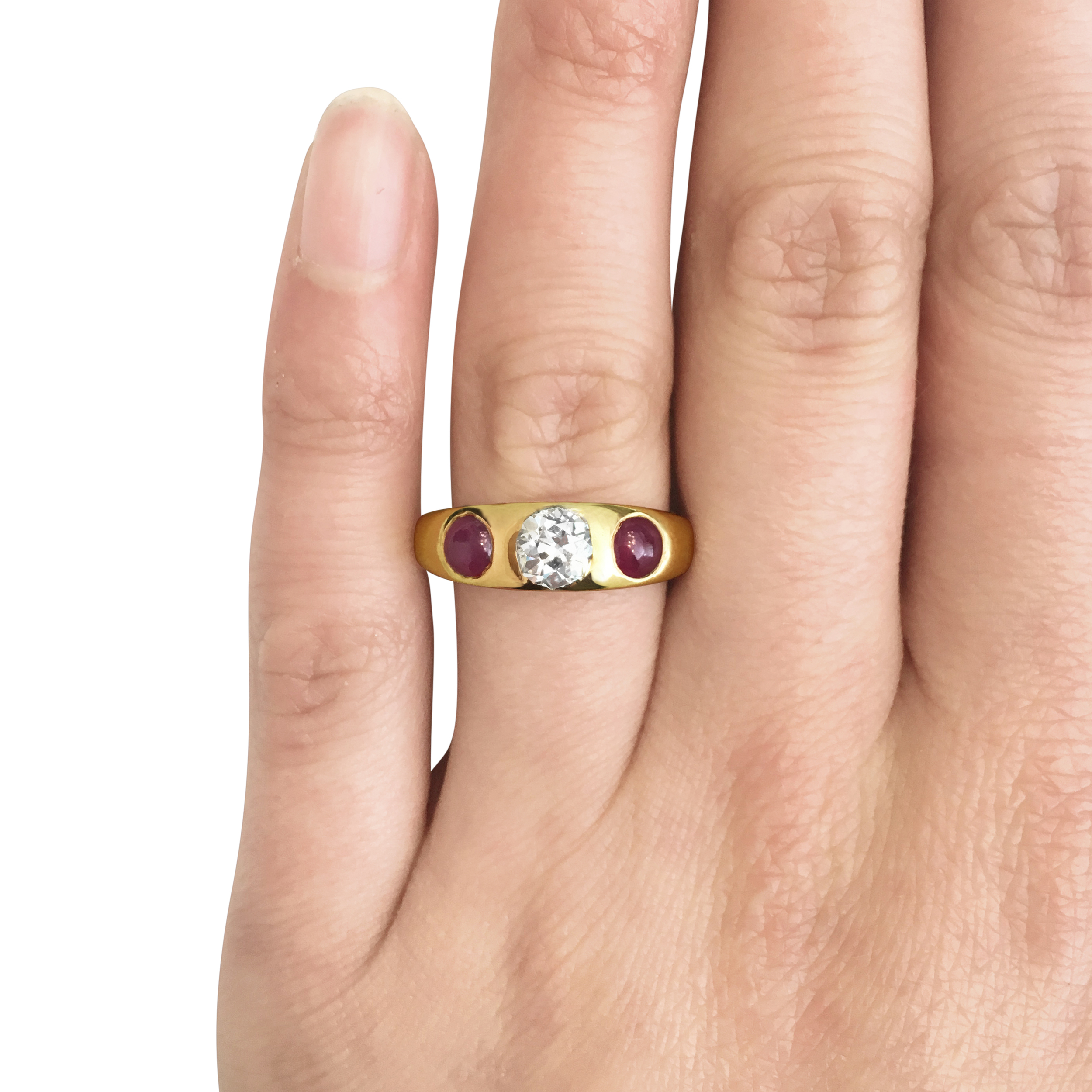 Antique diamond & ruby three-stone gypsy ring hand shot