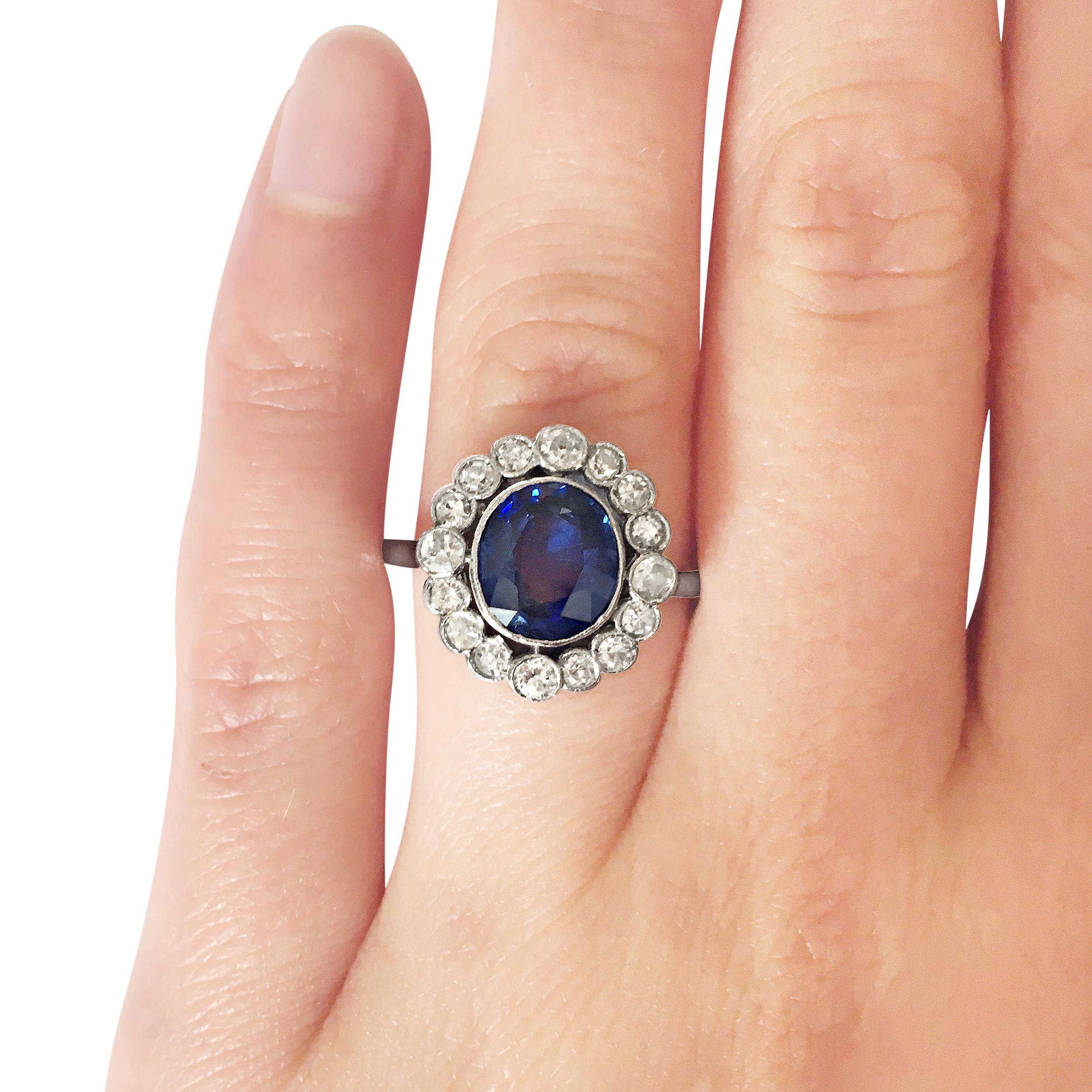 sapphire & diamond halo ring hand shot