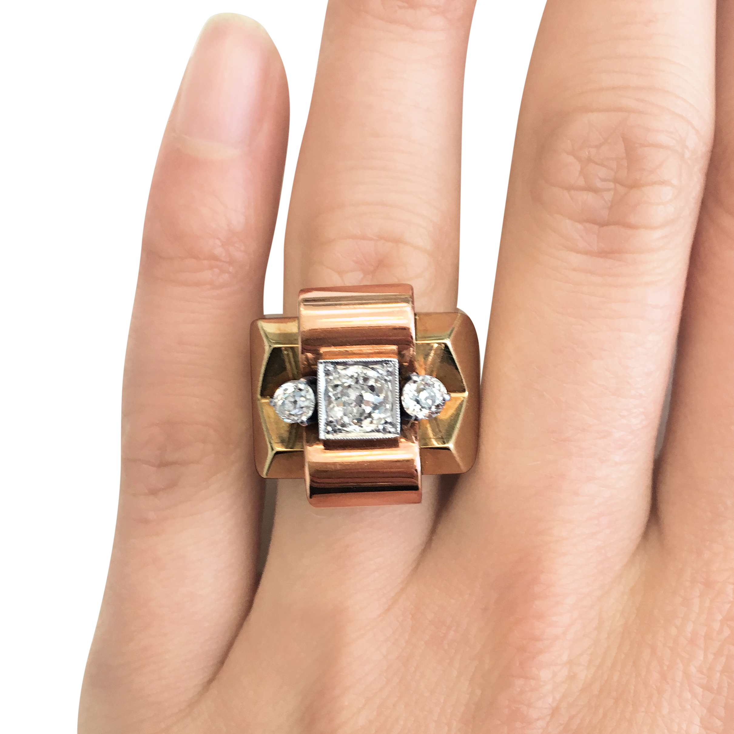 1950s three-stone diamond geometric ring hand shot