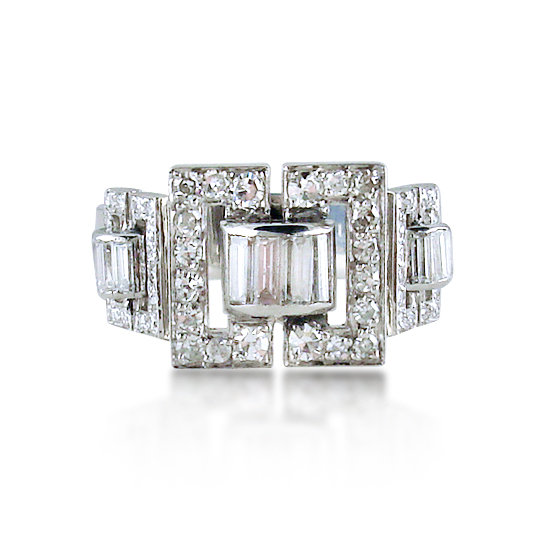 brilliant-and-baguette-cut-diamond-buckle-ring-mounted-in-platinum.jpg