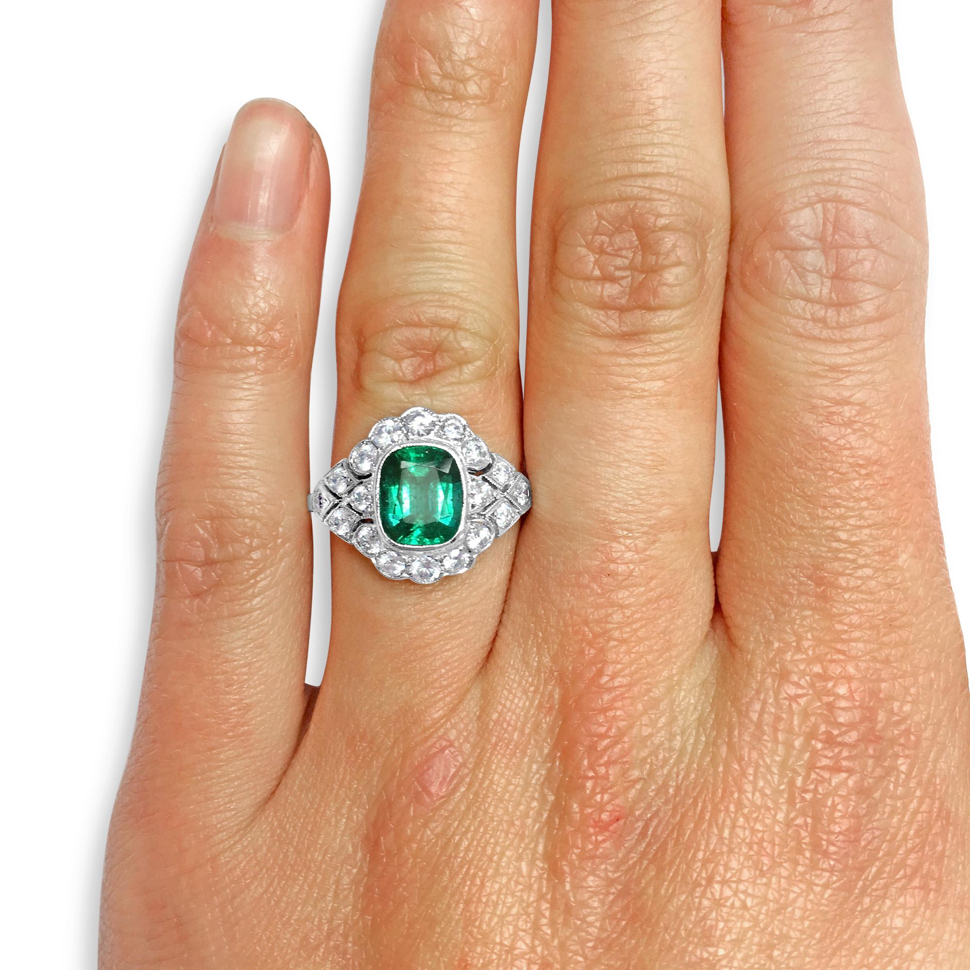 Cushion-cut Emerald ring hand shot