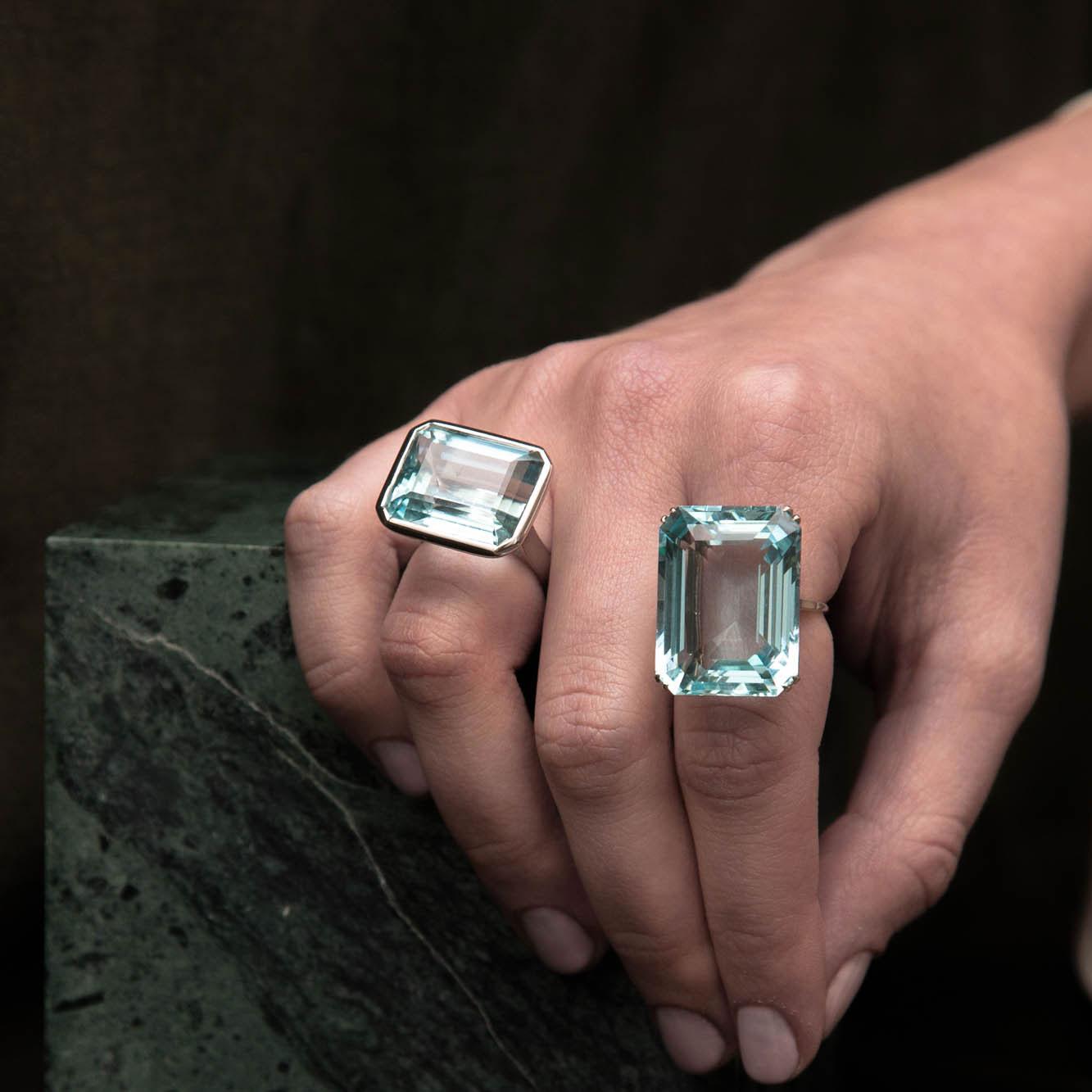 Aquamarine eight claw ring hand