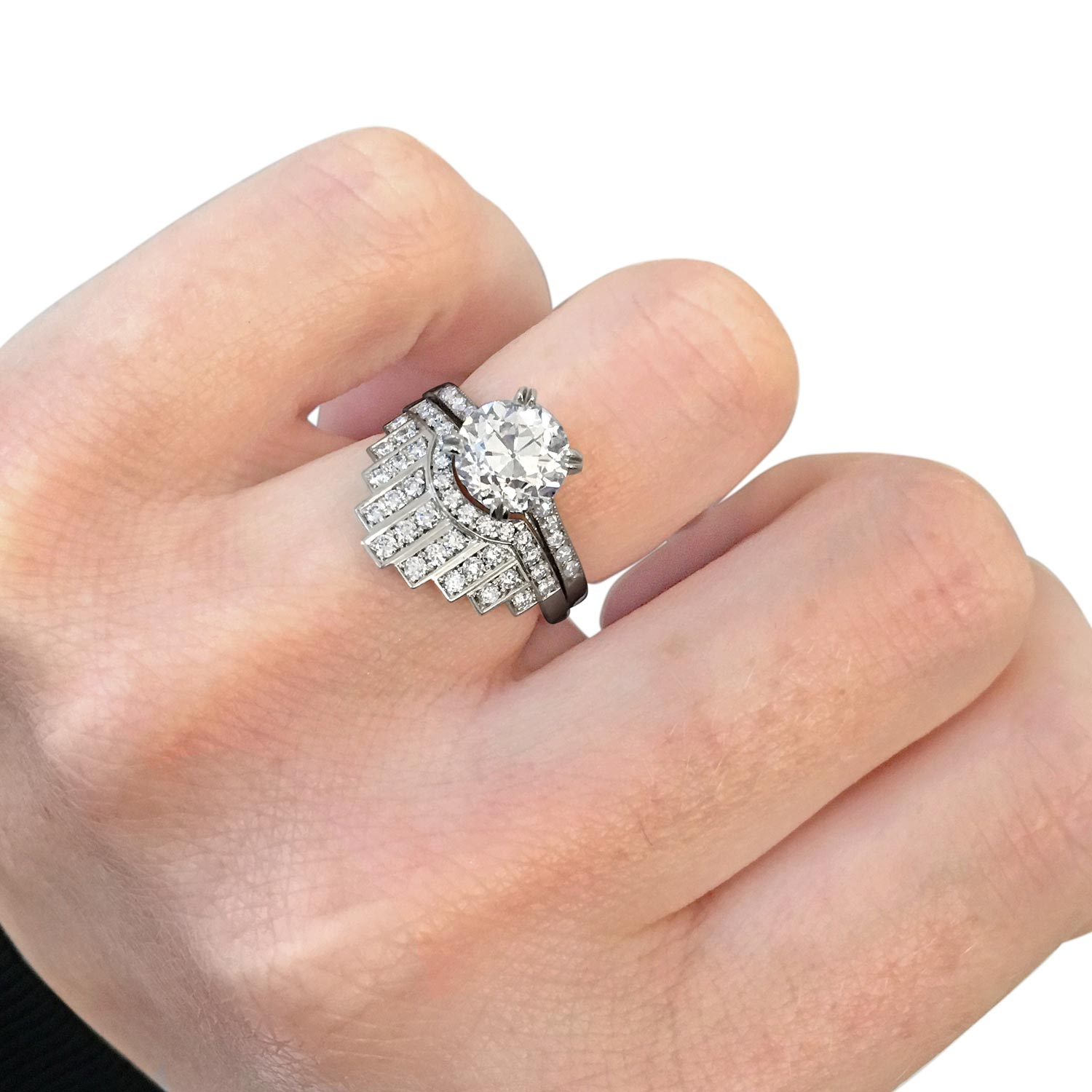 Bespoke fitted brilliant-cut diamond and platinum wedding ring hand