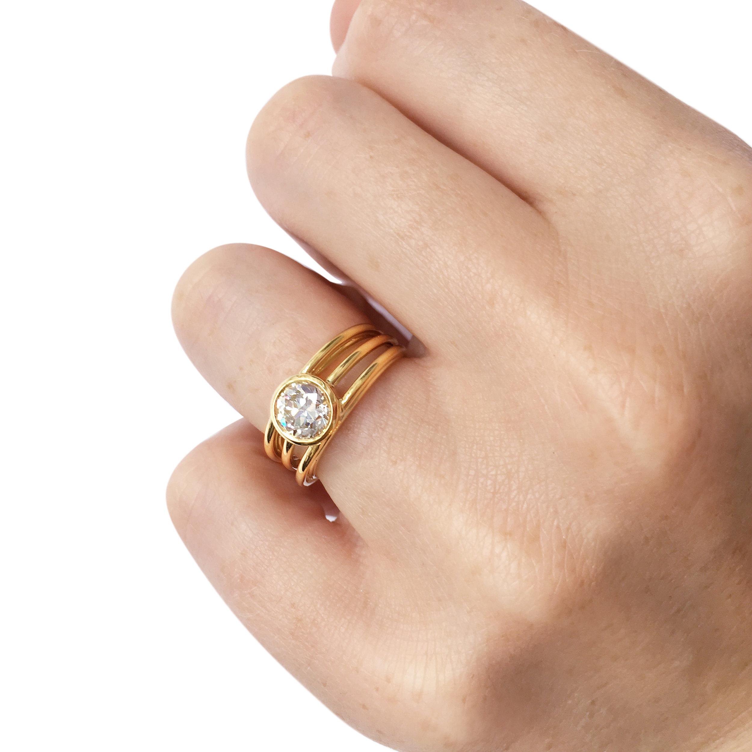 Diamond three row ring on hand