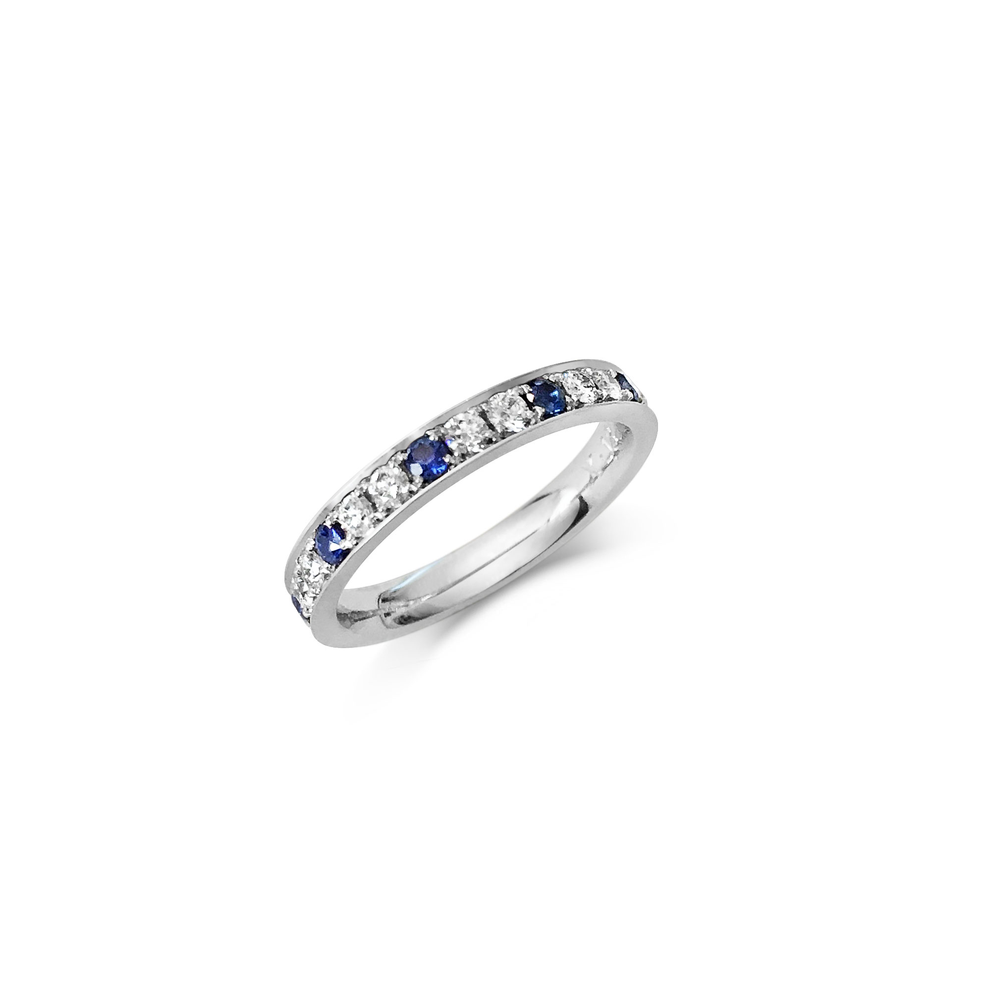 Sapphire and diamond eternity ring in platinum