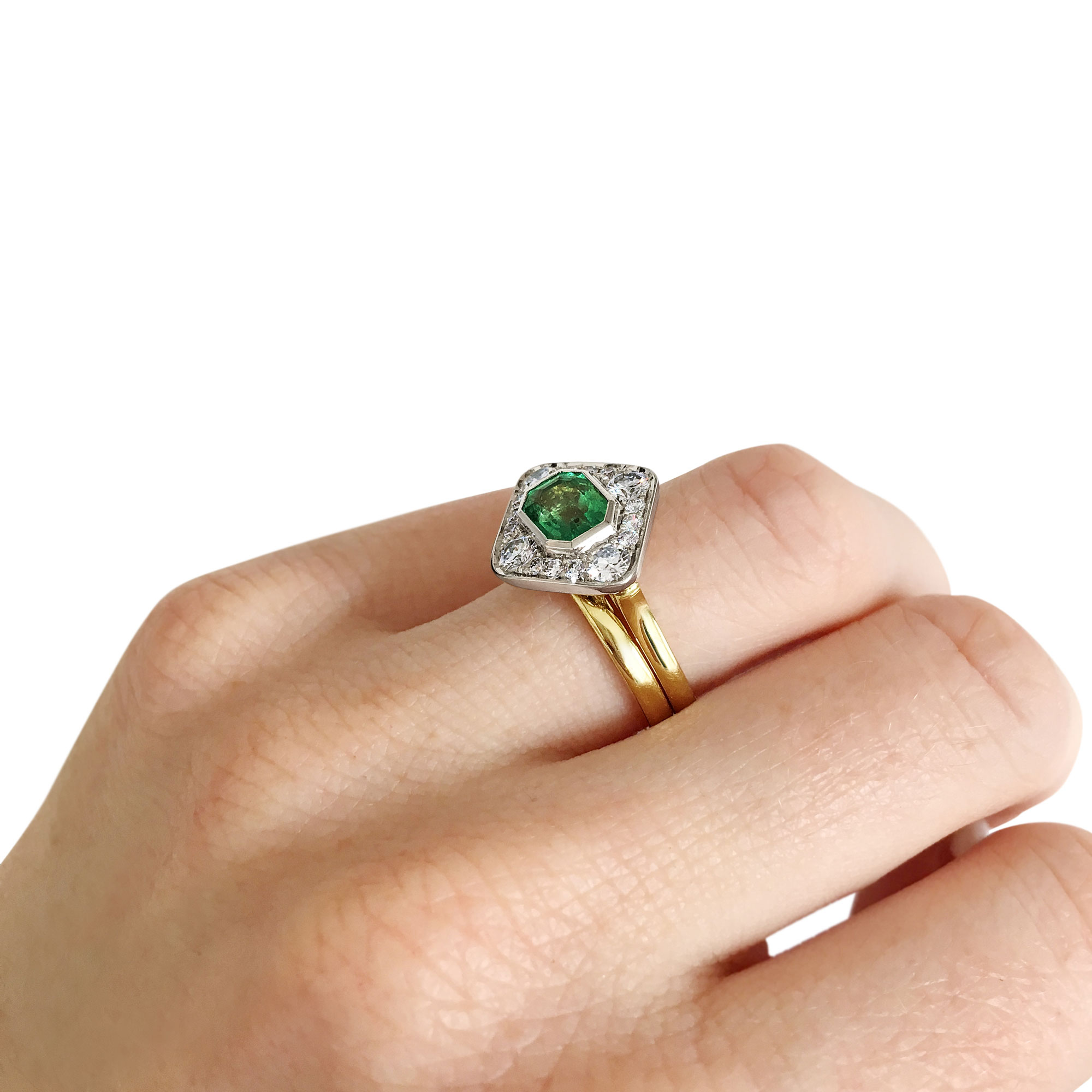 Emerald and diamond panel ring mounted in 18ct white and yellow gold on hand