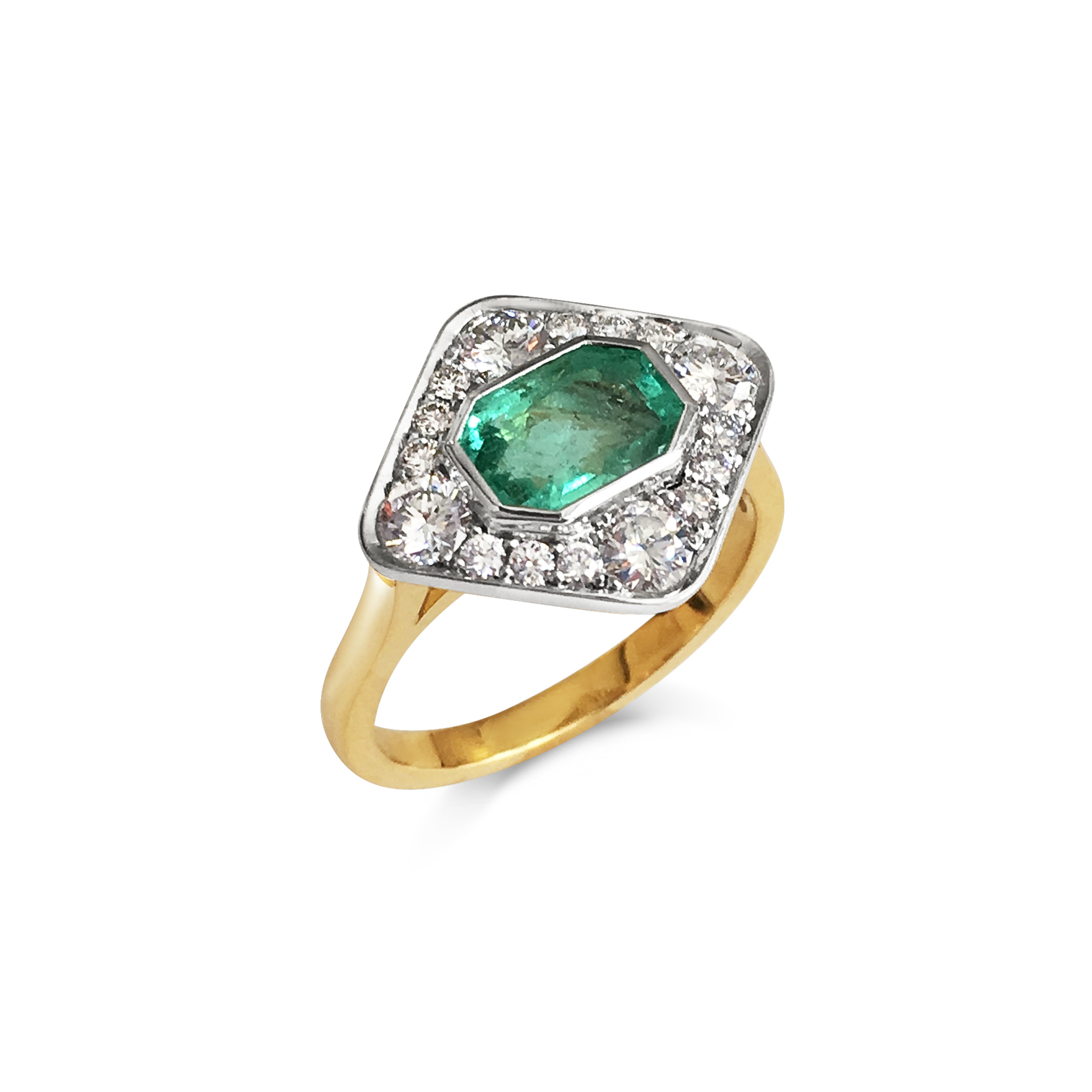 Emerald and diamond panel ring mounted in 18ct white and yellow gold