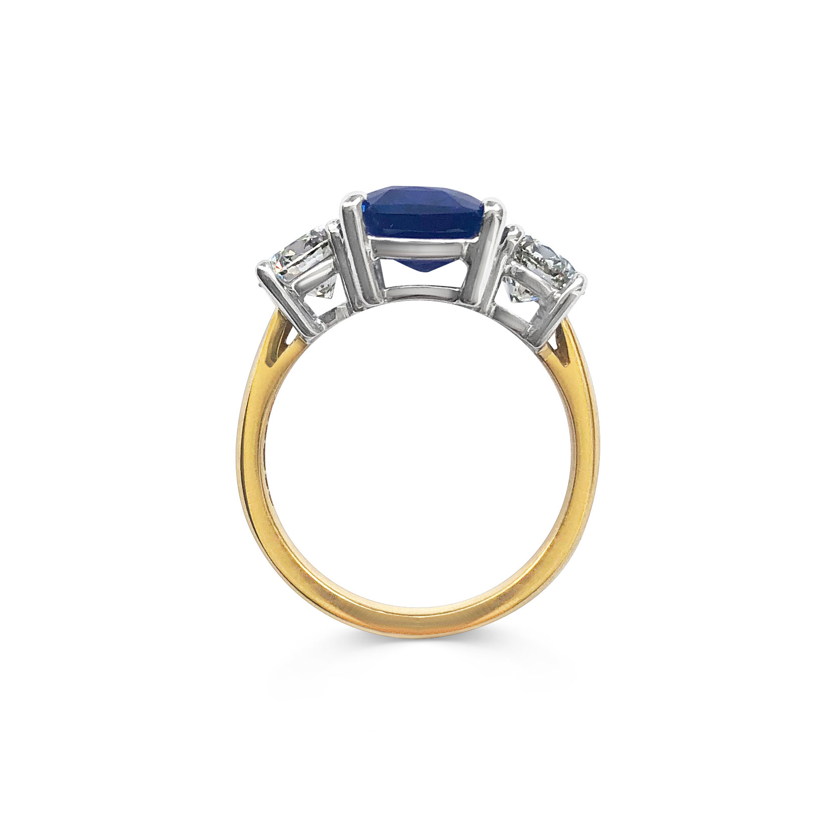 Emerald-cut Sapphire and diamond three stone ring set in 18ct yellow gold.