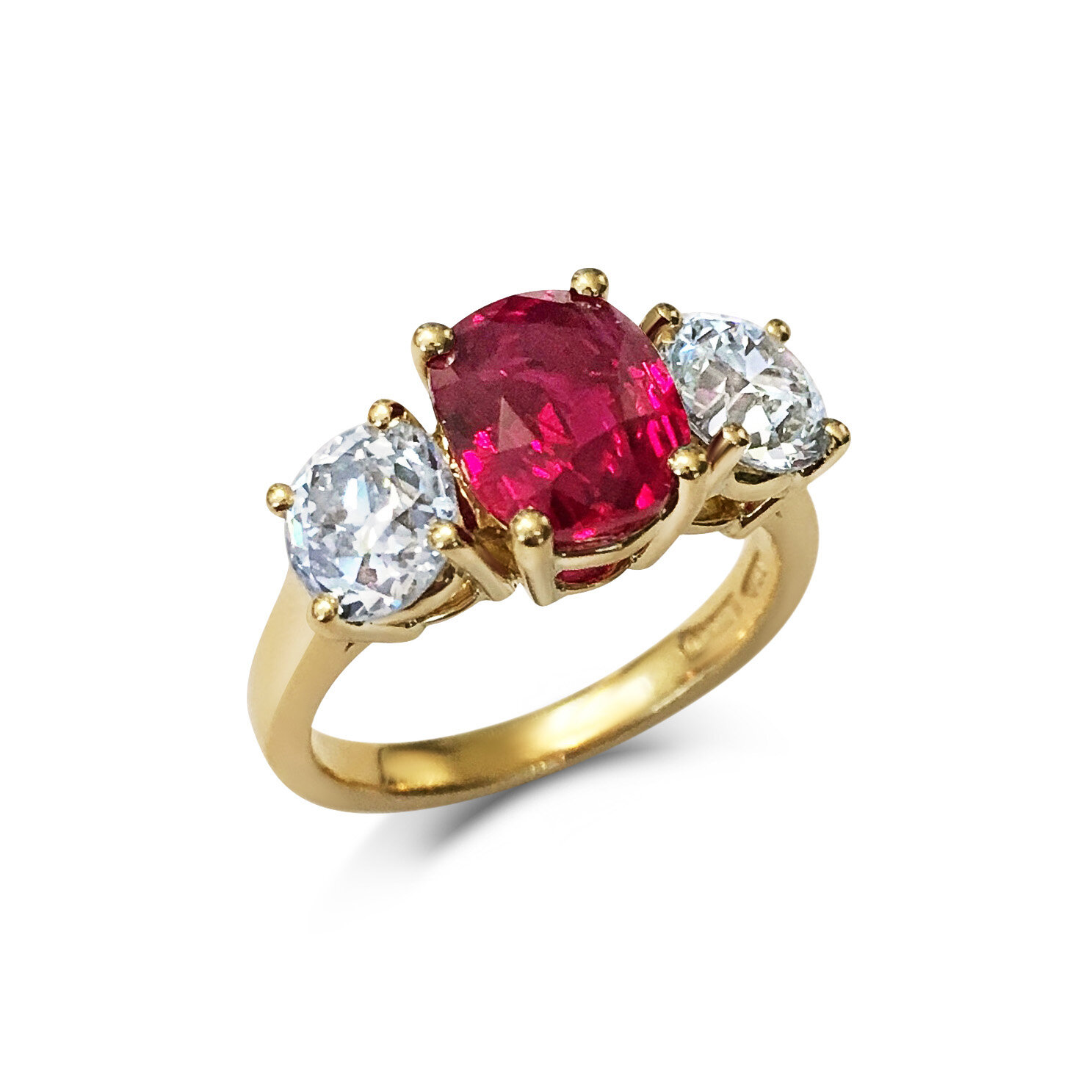 Ruby and Diamond three-stone ring mounted in 18t yellow gold.