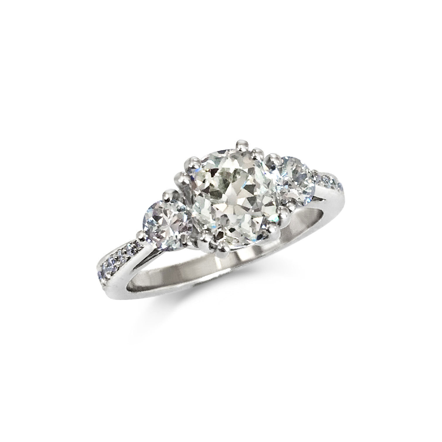 Diamond three-stone engagement ring with a diamond shank mounted in platinum.