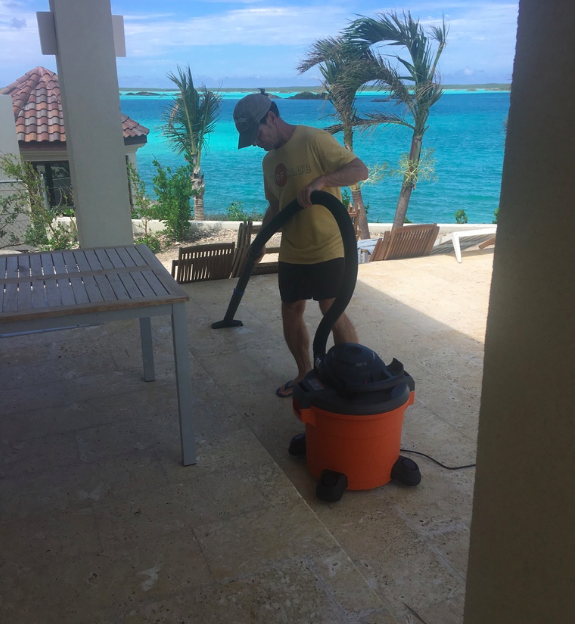 Johnny works a mean Shop Vac on the patio!