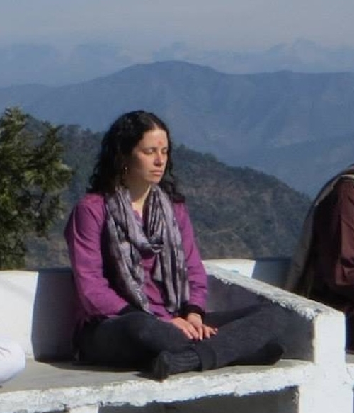 Meditating with the Himalayas in the background on my first trip to India.