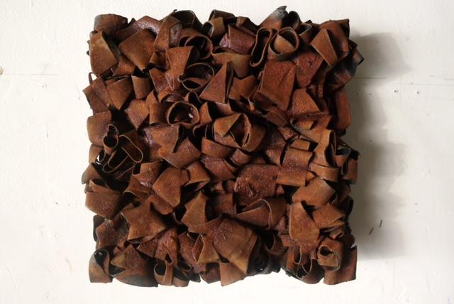 """Designer Rust"" -  iron powder, rubber, 12 x 12 x 3 inches (2017)"