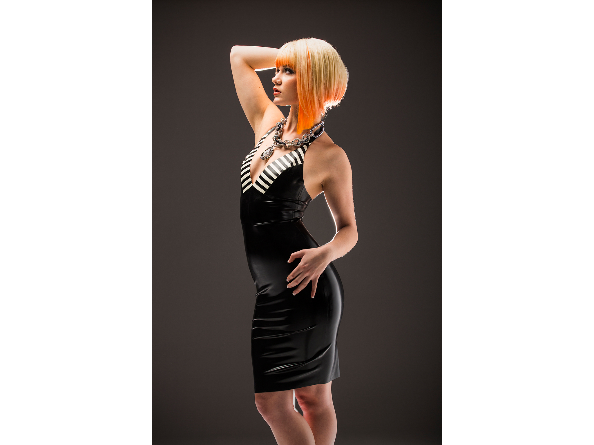 Fashion shot of blonde woman in black and white latex dress