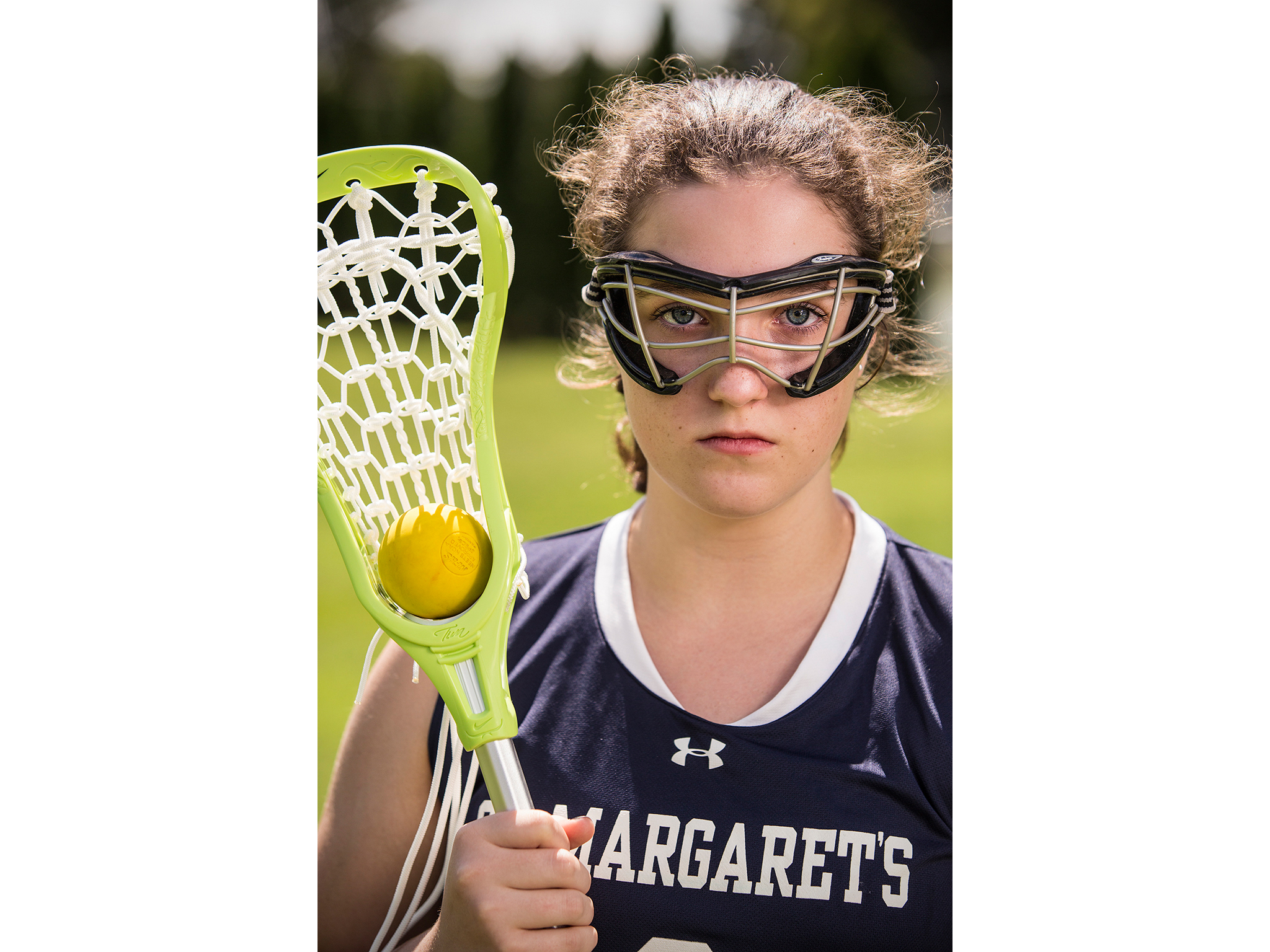 Private school girl's lacrosse player photo with stick and ball