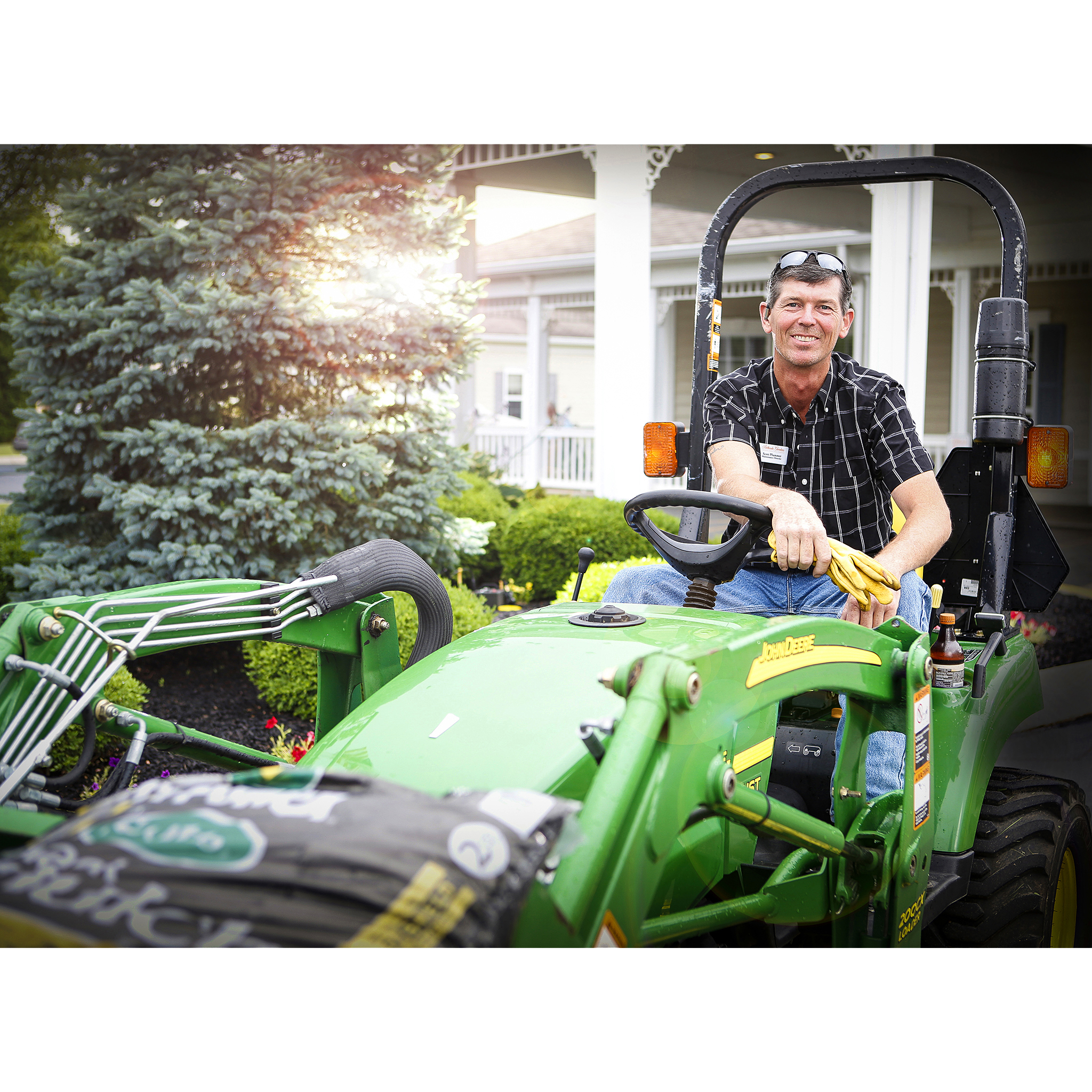 Man on John Deere tractor for website by Craig Anderson