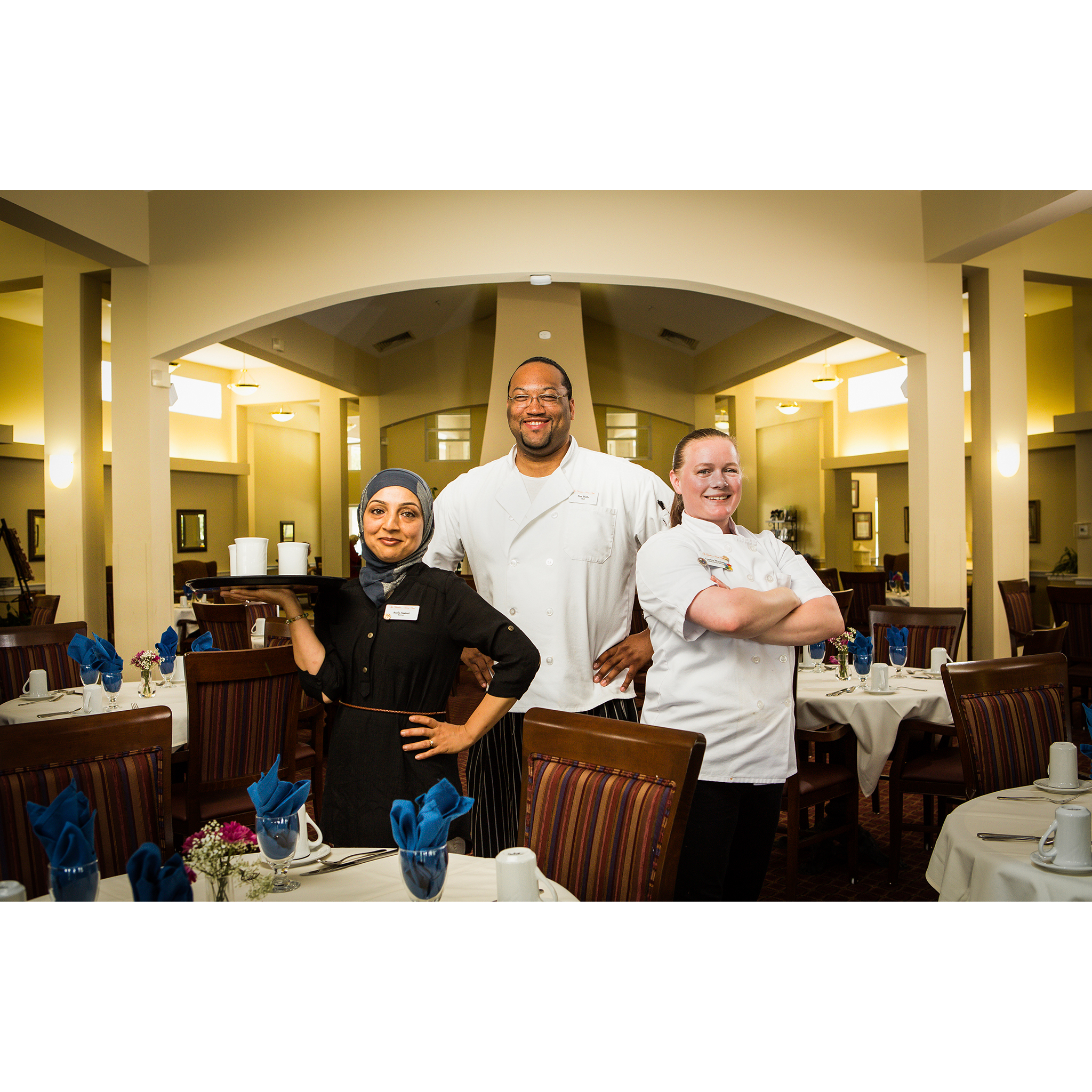 Portrait of restaurant server and chefs