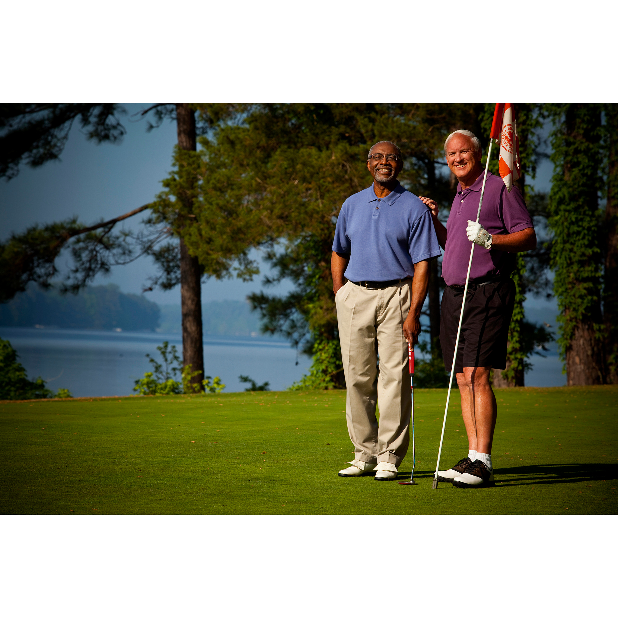 Photo of retired gentlemen on golf course green