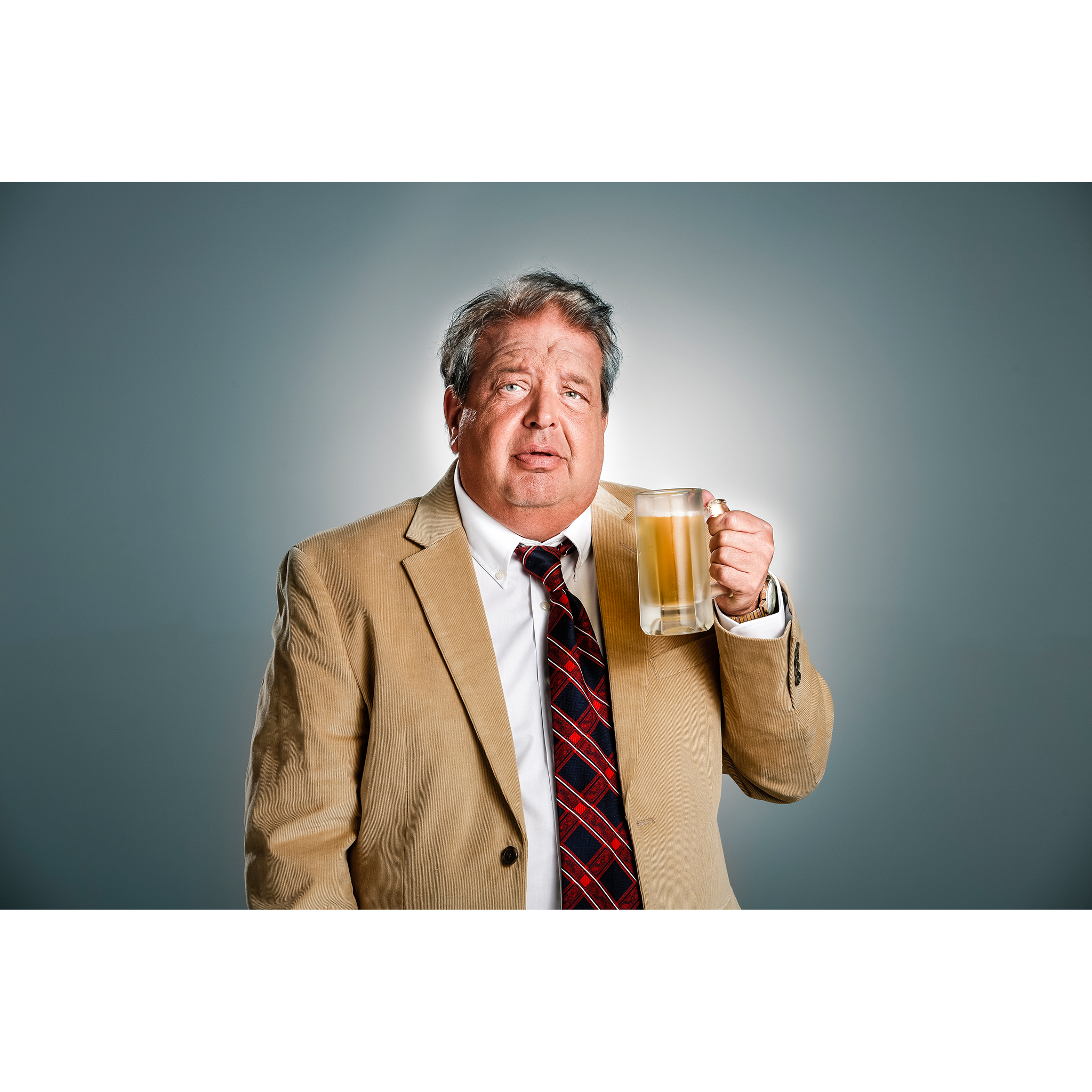 Portrait of man in sport coat drinking beer in mug by photographer Craig Anderson