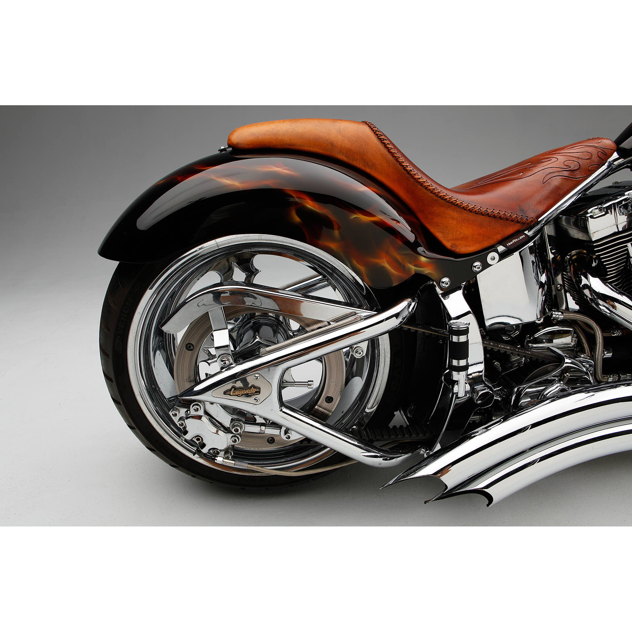 Photo of a custom motorcycle chopper paint and exhaust pipes