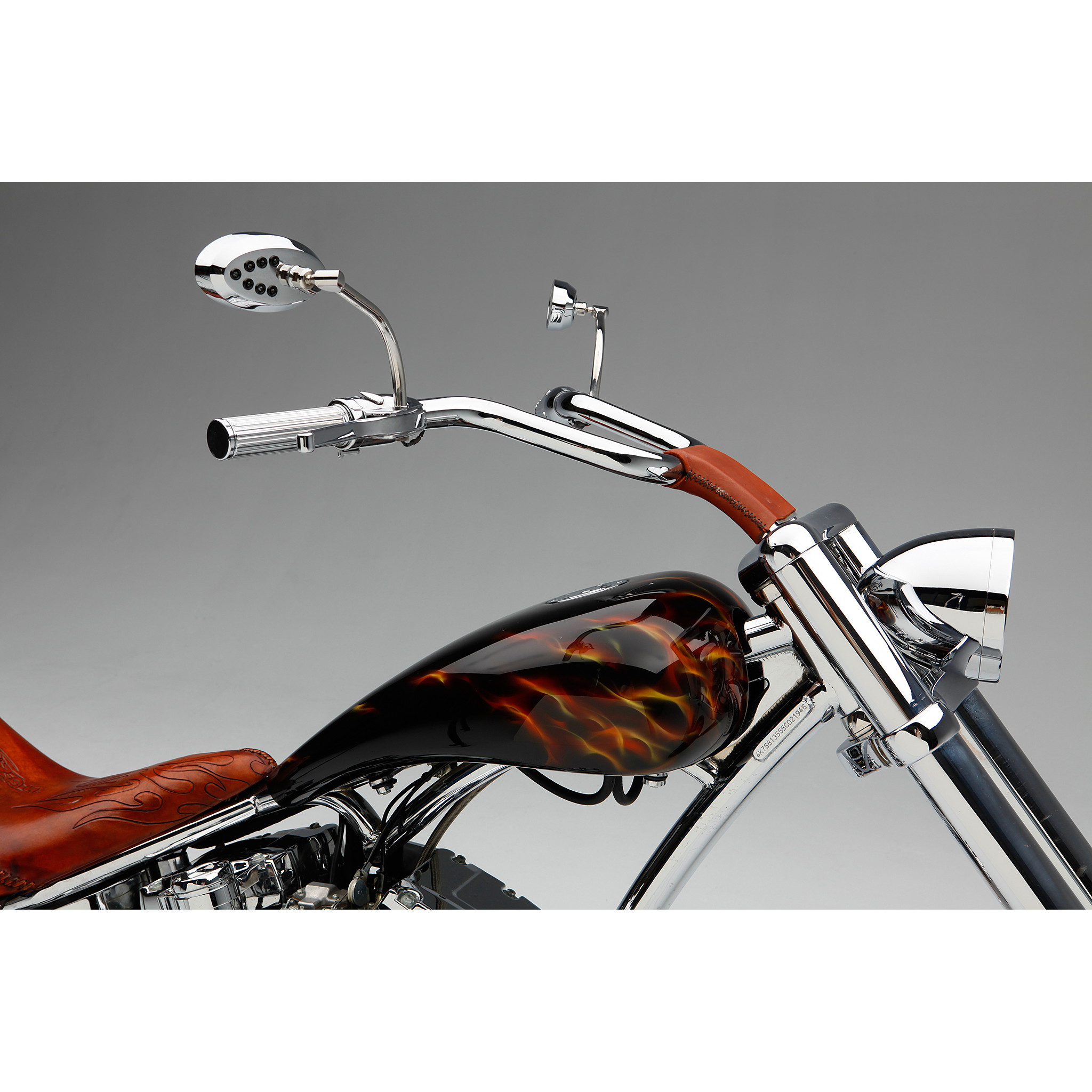 Studio photo of a custom motorcycle chopper handlebars and paintwork