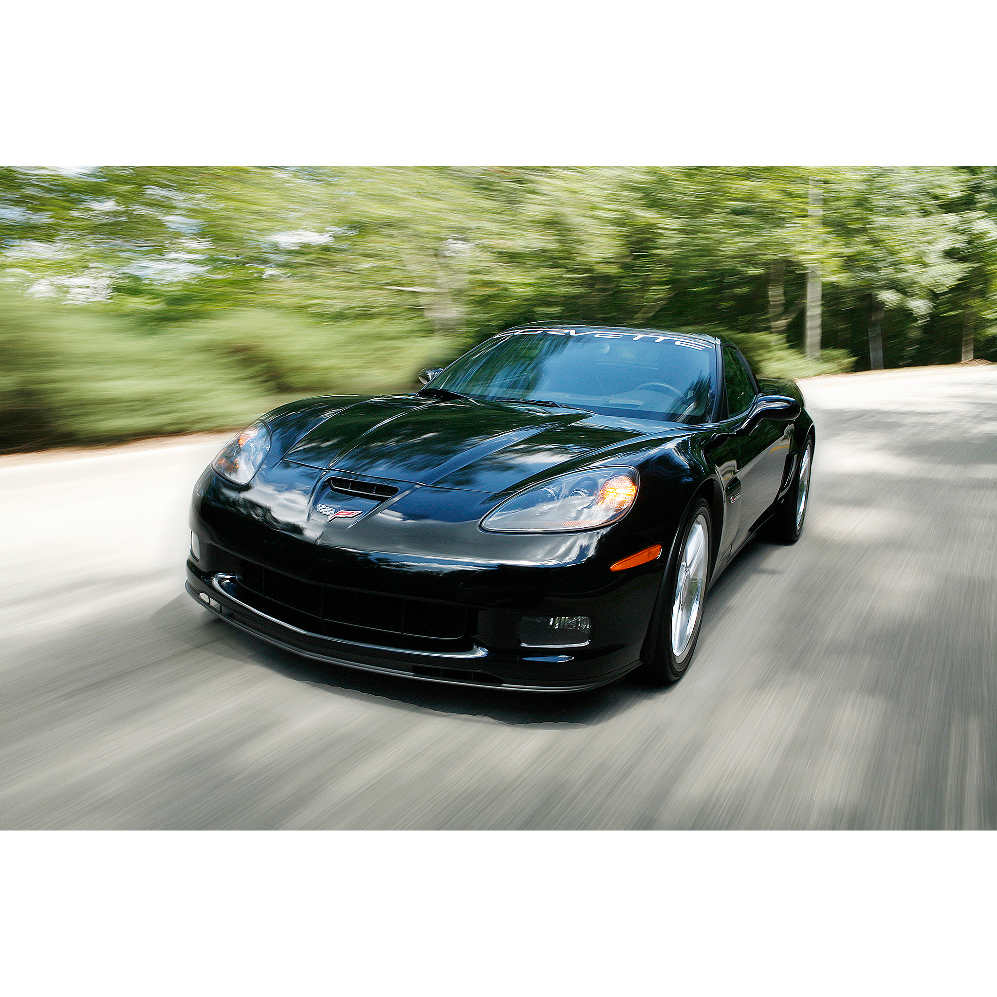 Photo of a Chevrolet Corvette driving down the road