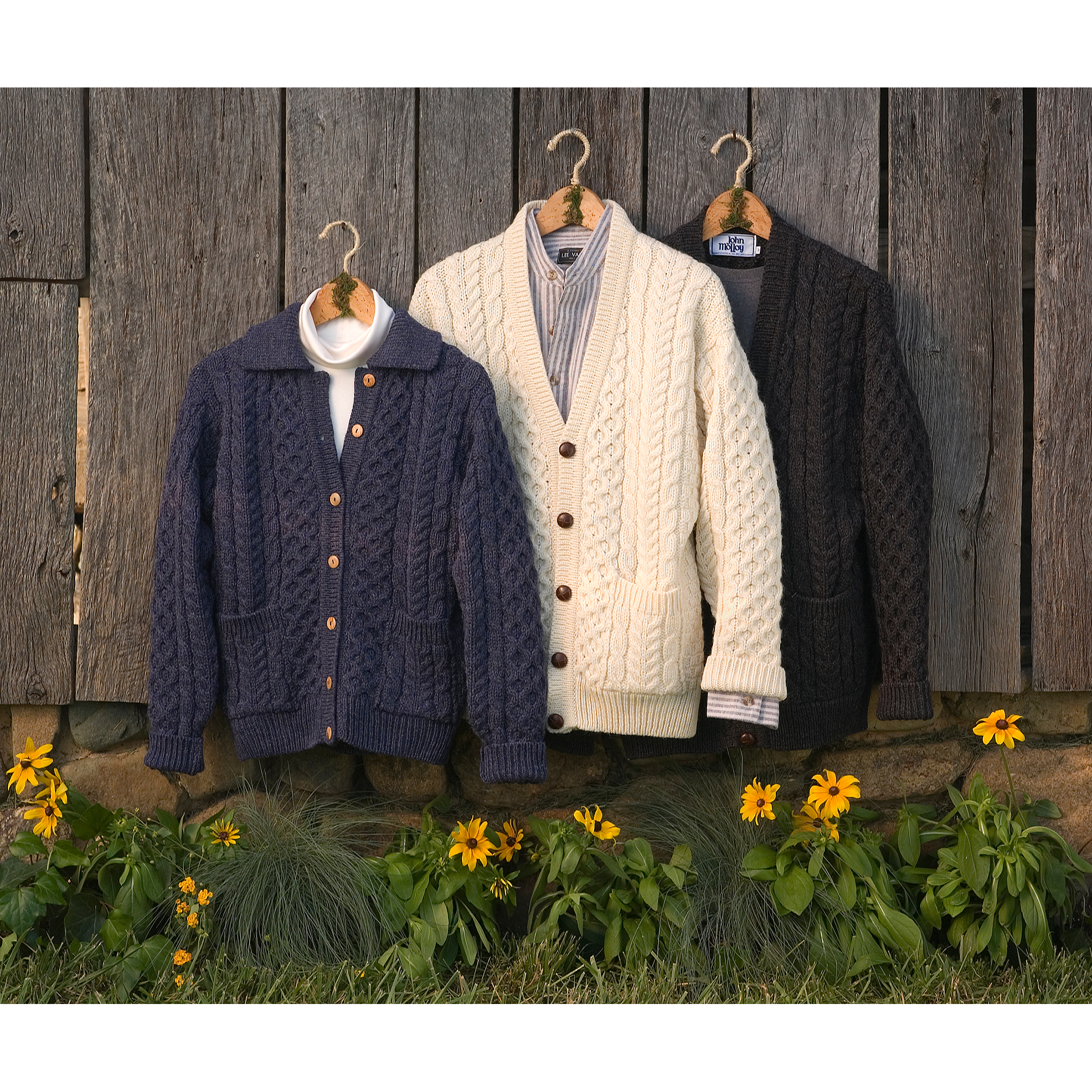 3 sweaters on a barn with flowers for website product sales
